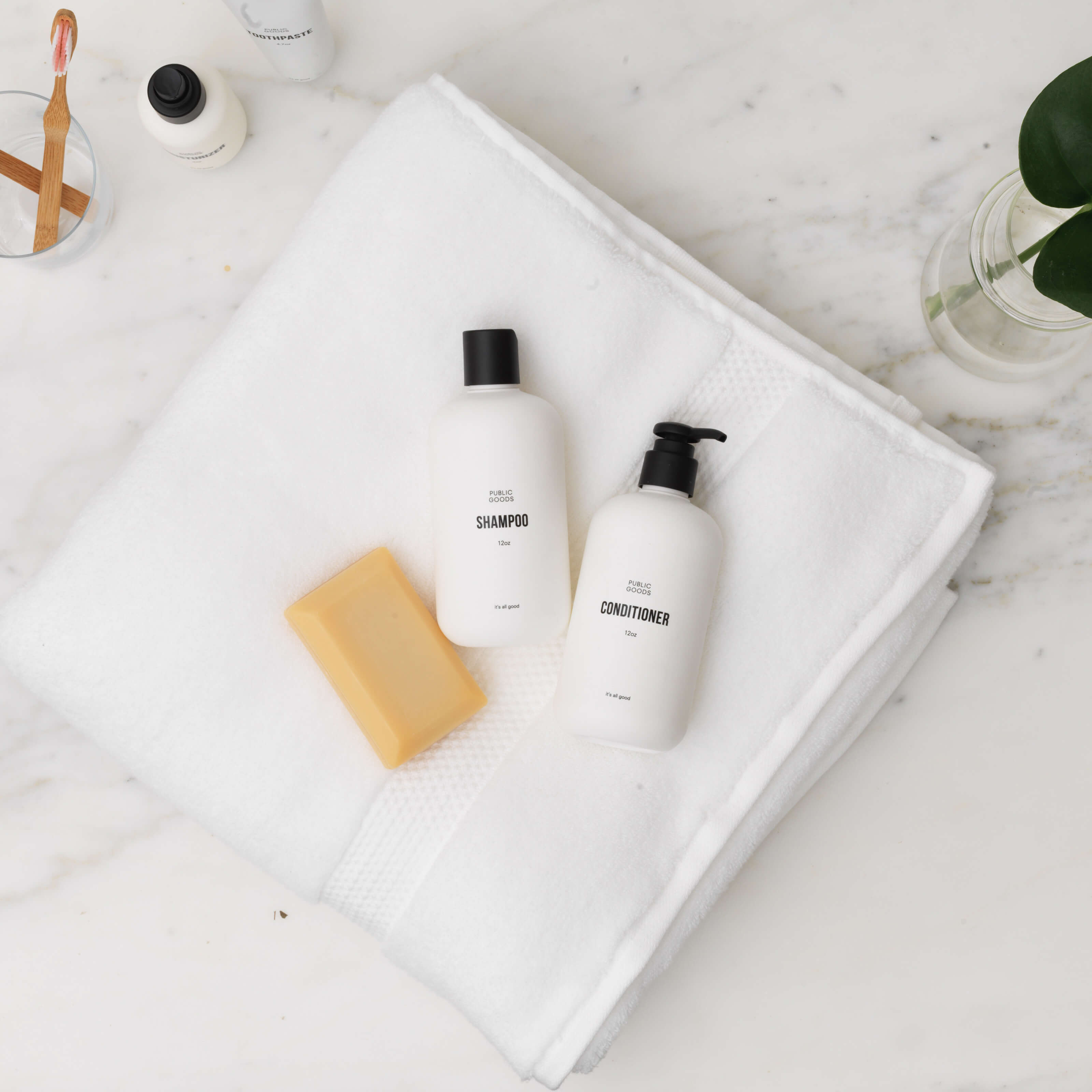 public goods personal care products, towel, bathroom counter