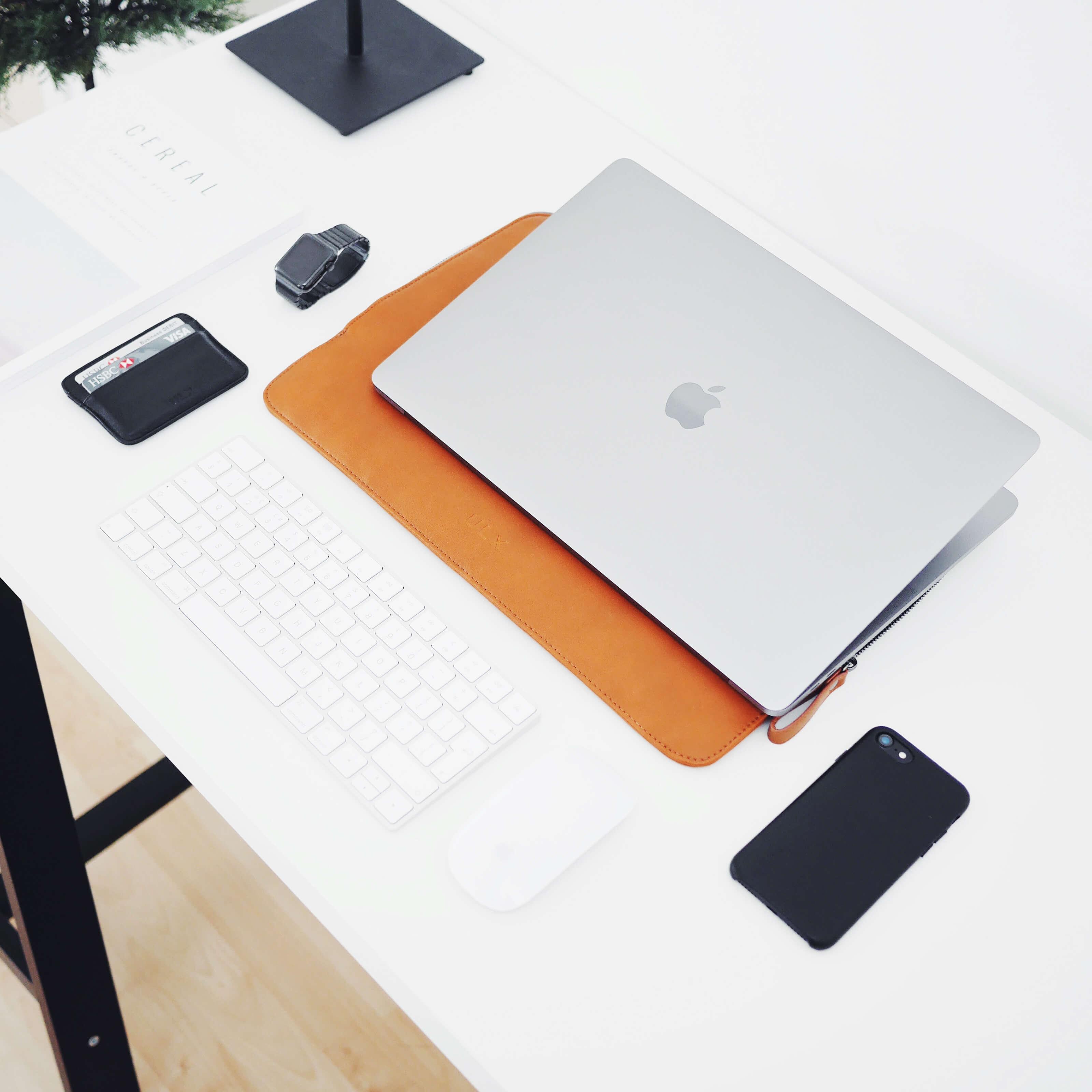 macbook ,standing desk, phone ,office supplies