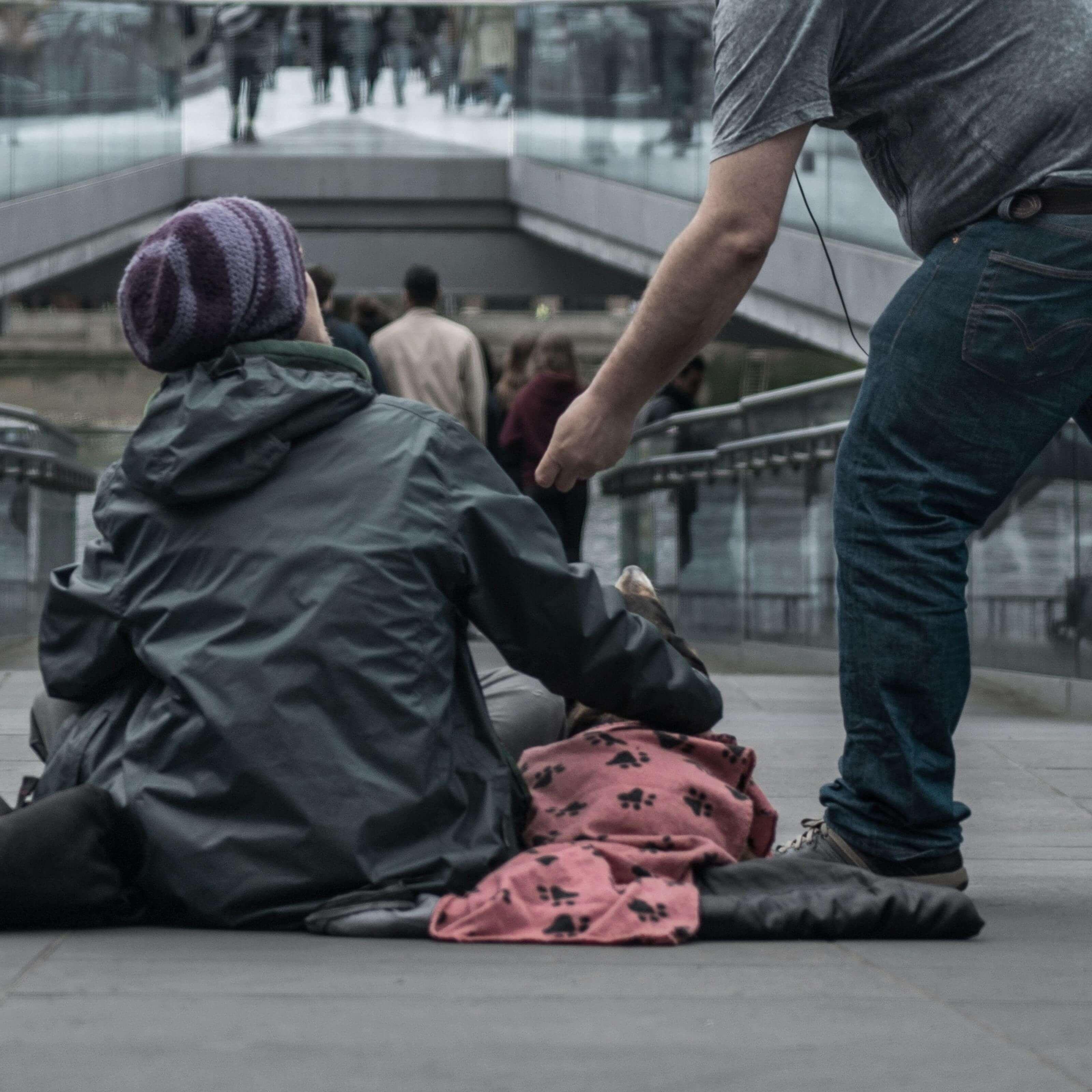 man helping homeless