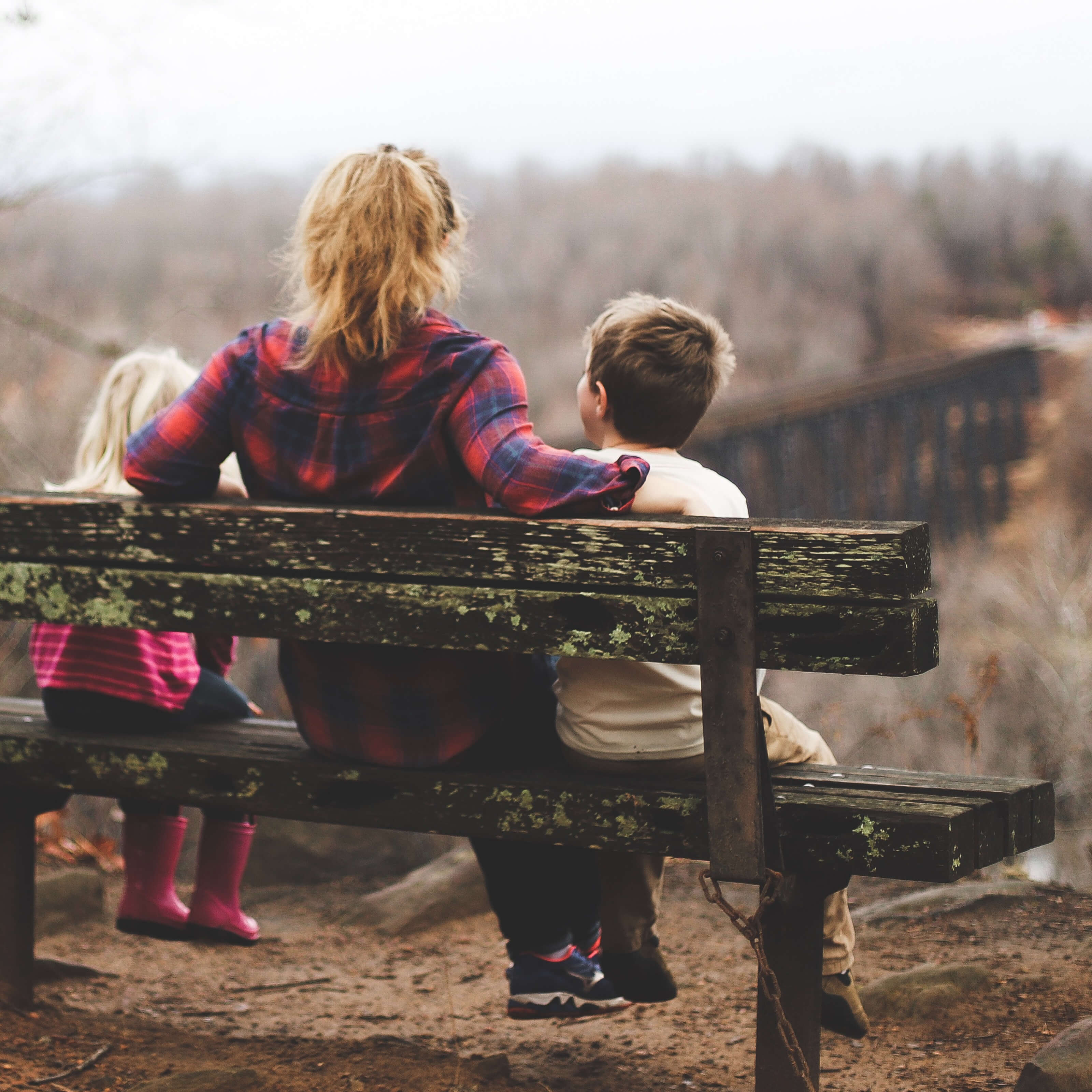 mom young son daughter sitting on park bench thumbnail image