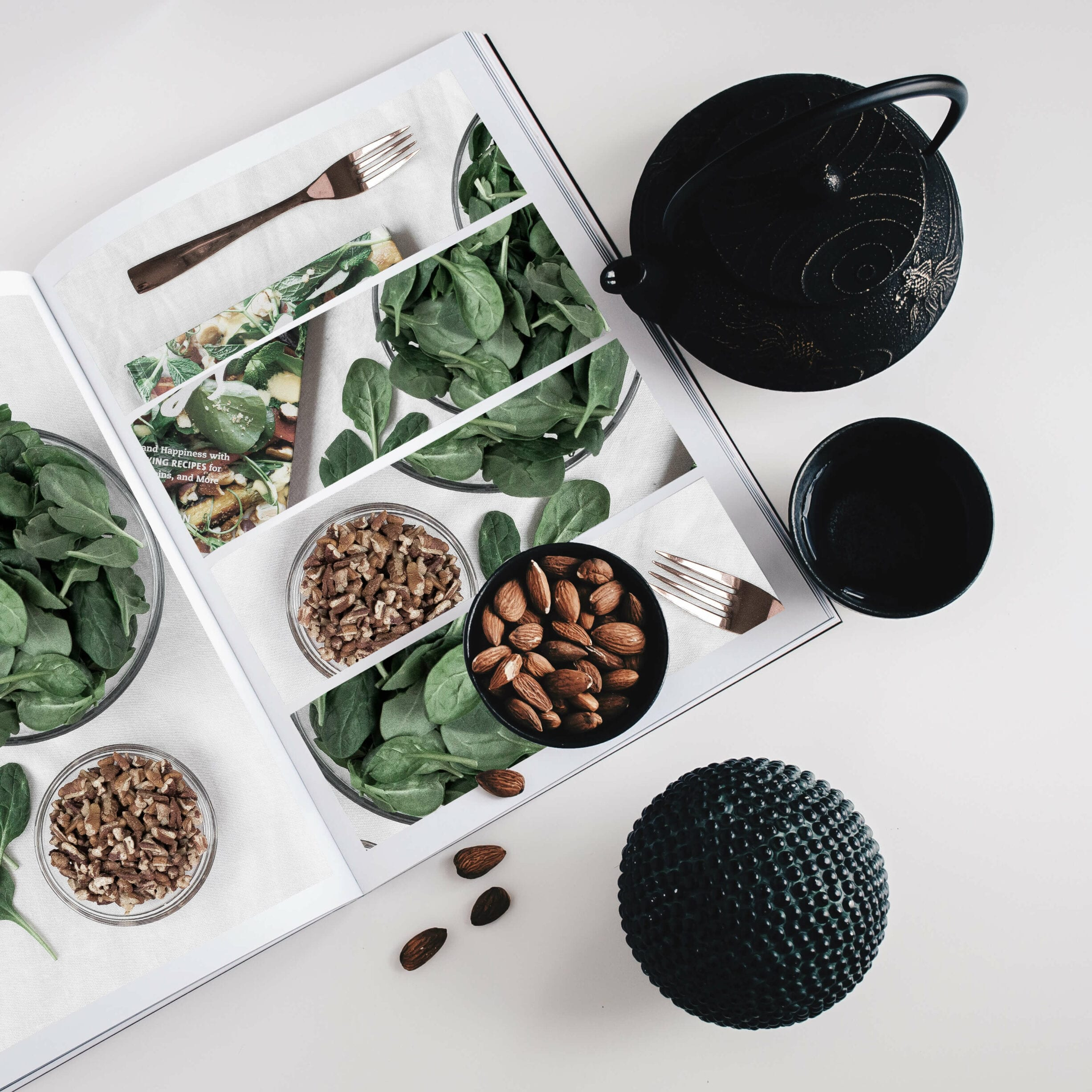 book, pictures of food, bowls, almonds, tea kettle