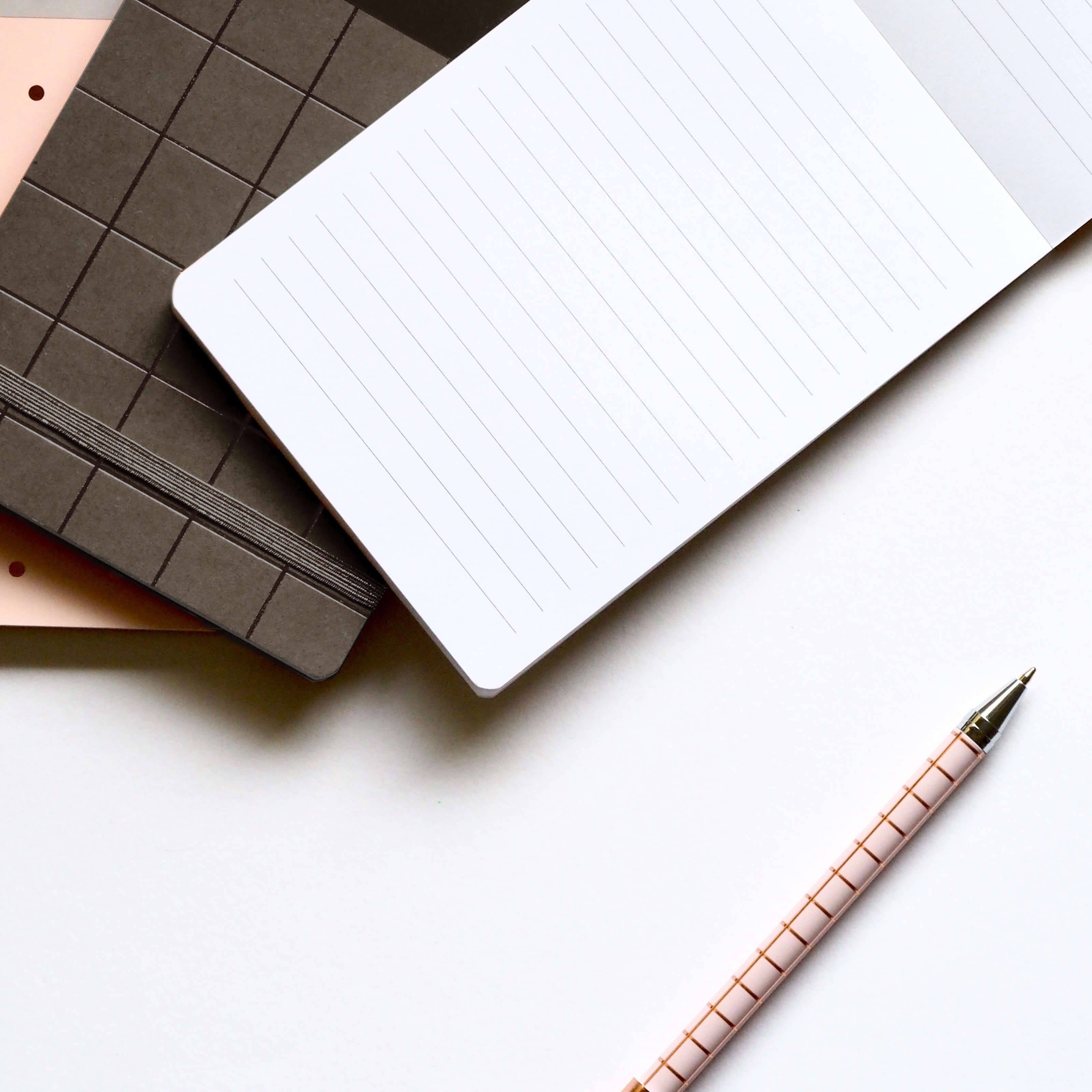 notebooks on desk blank page pink pen thumbnail image