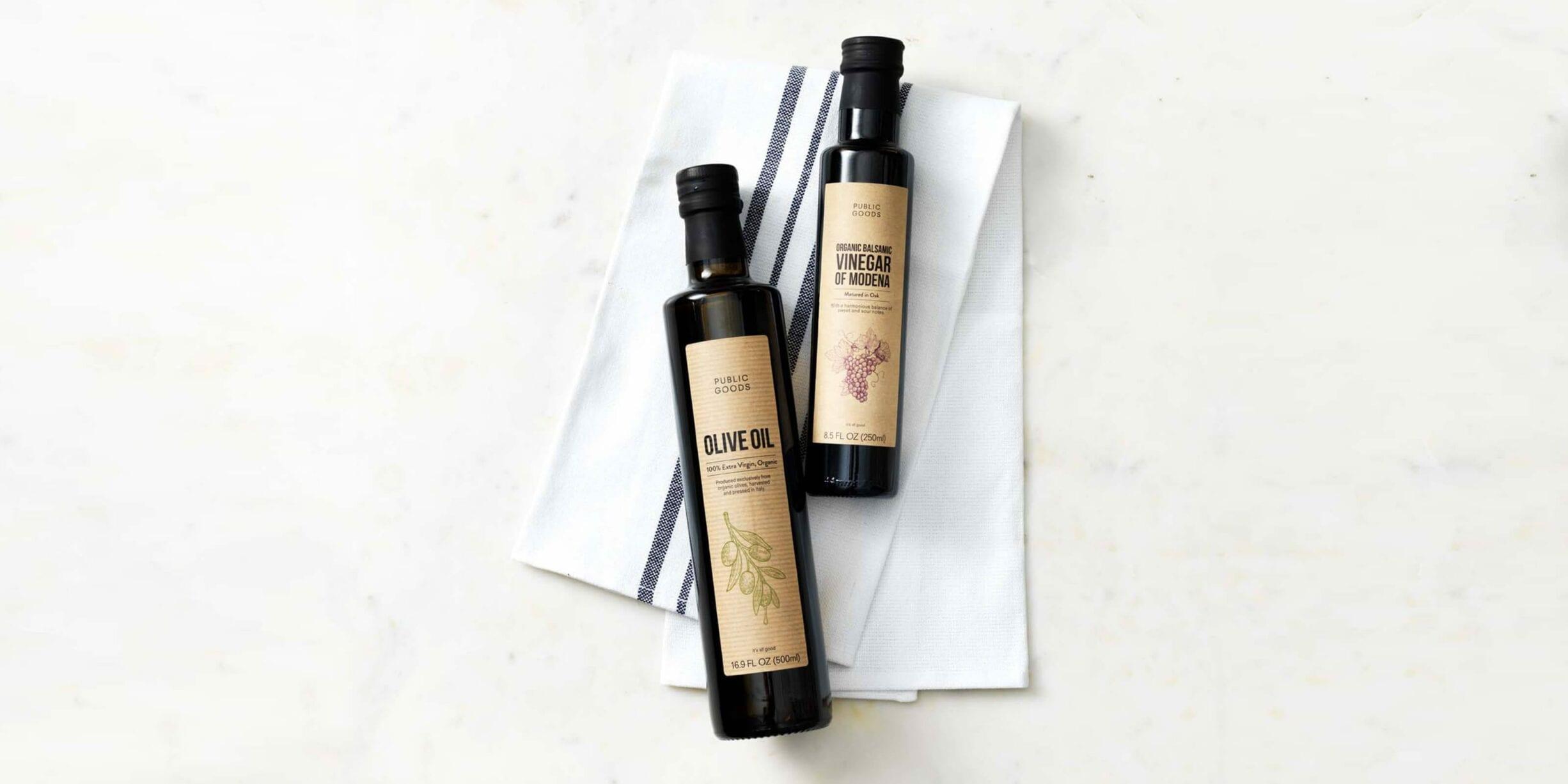 public goods olive oil and vinegar bottles, kitchen towels