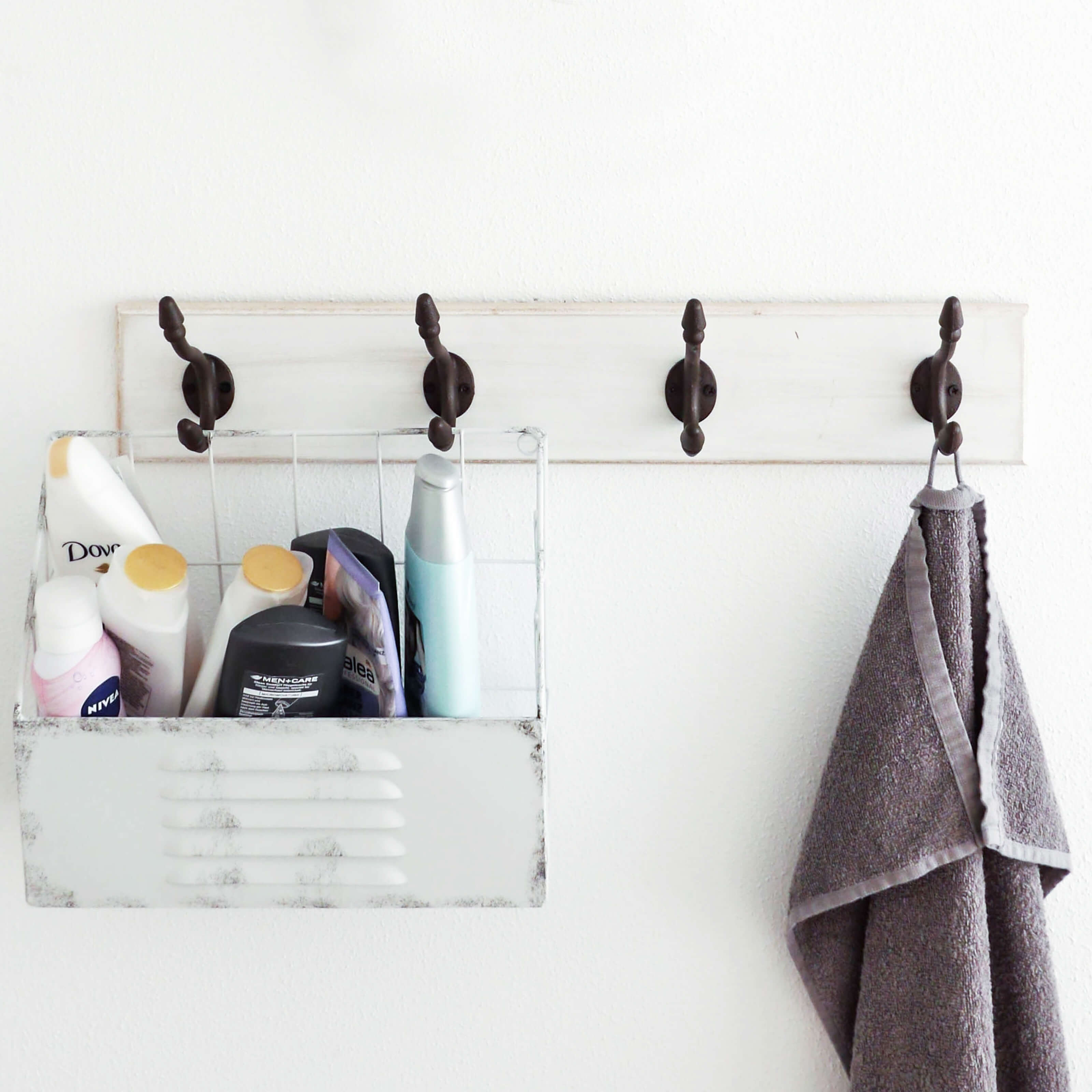 towel rack, shower caddy, shampoo bottles