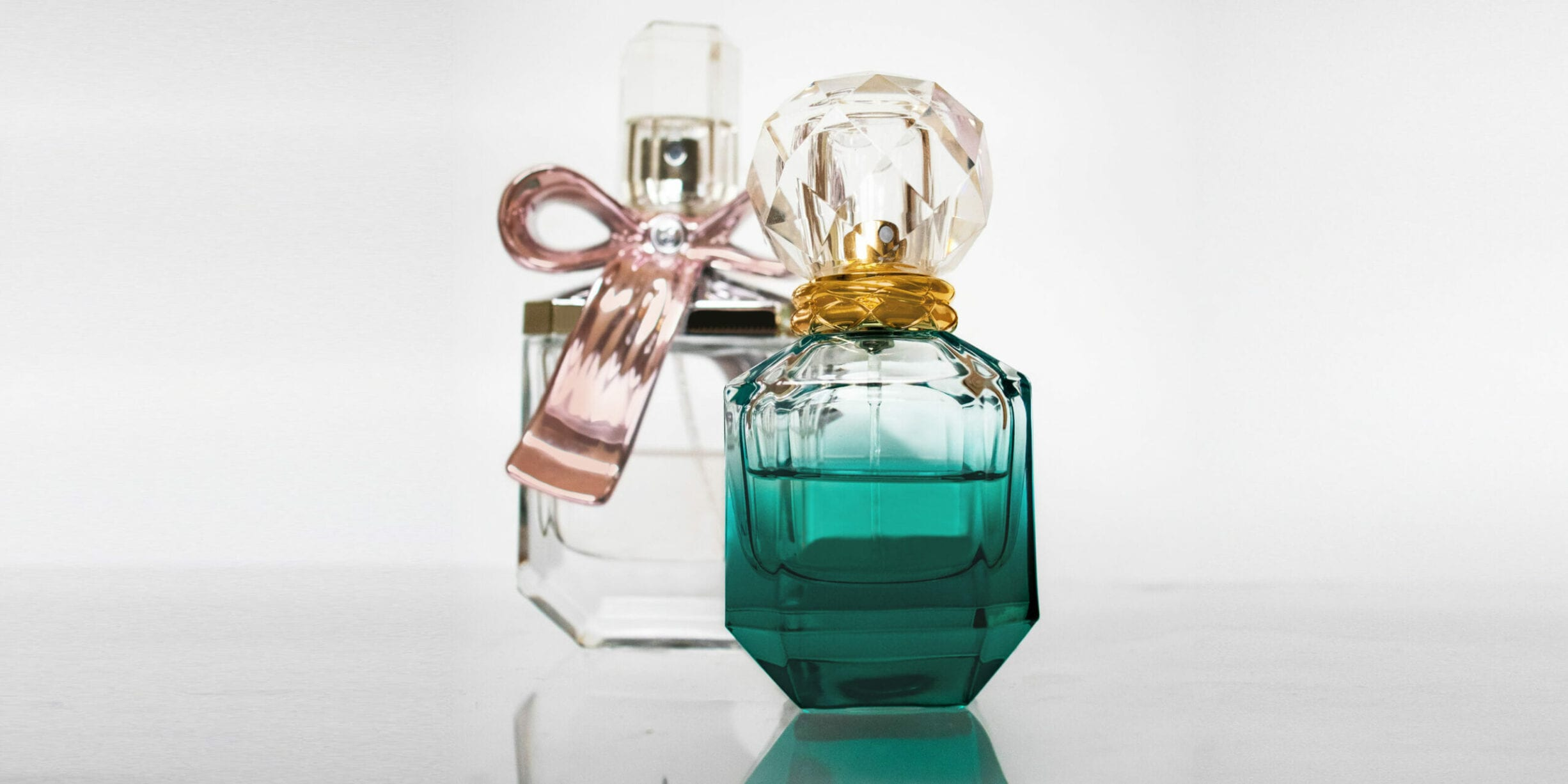 perfume bottles ribbons feature image