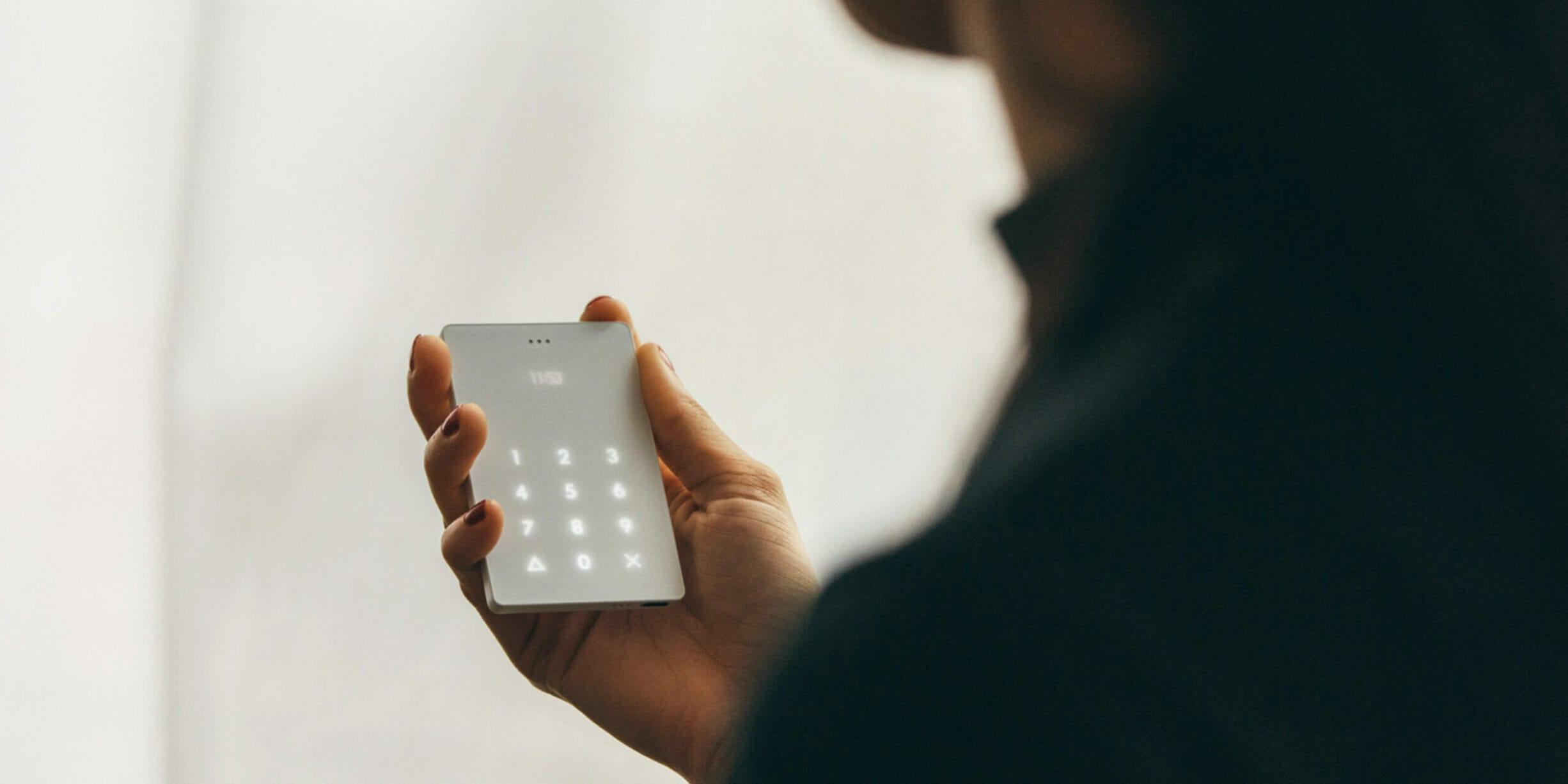 woman holding light phone