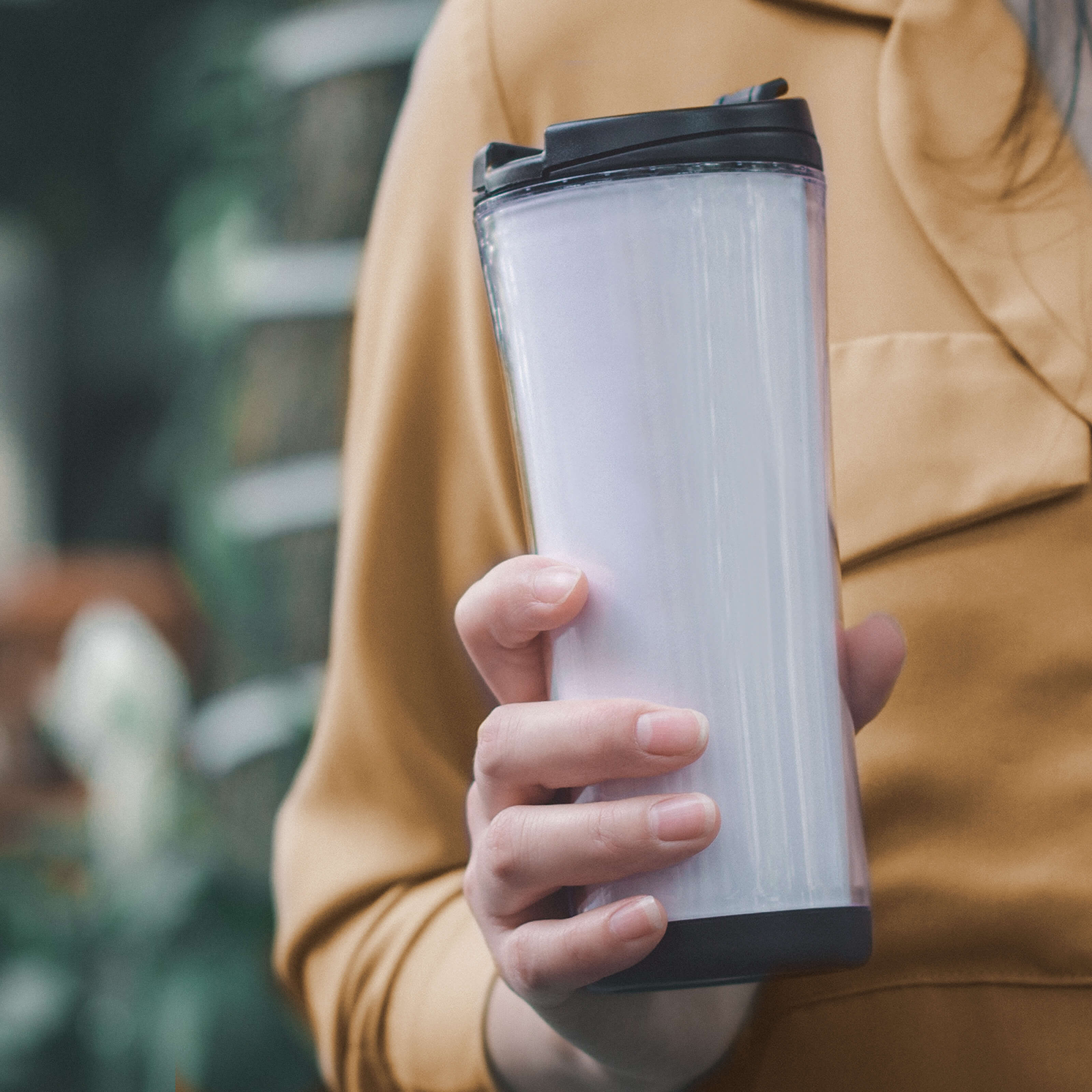 woman holding reusable cup