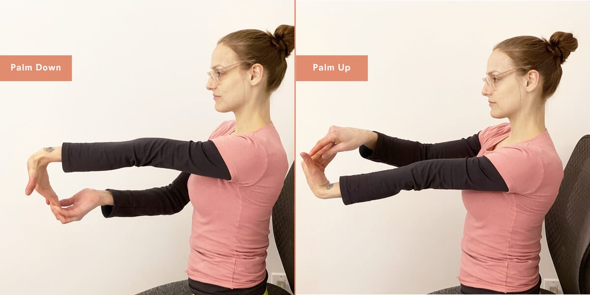 woman stretching arms and palms on office chair