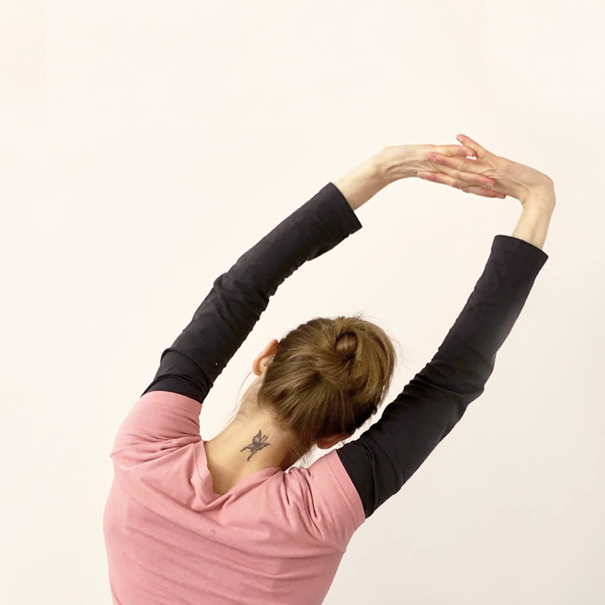 woman doing reach for the stars stretch