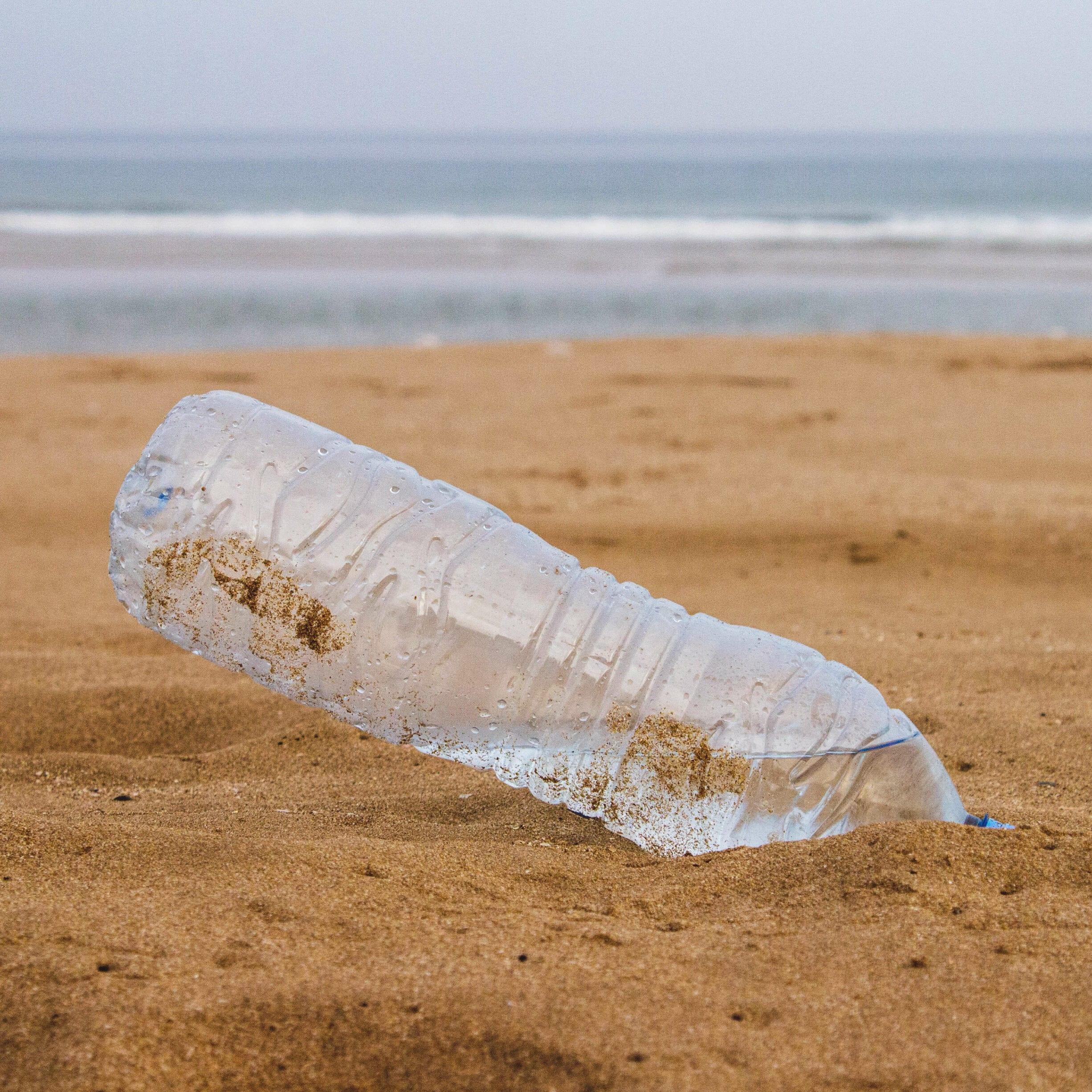 plastic bottle in beach sand