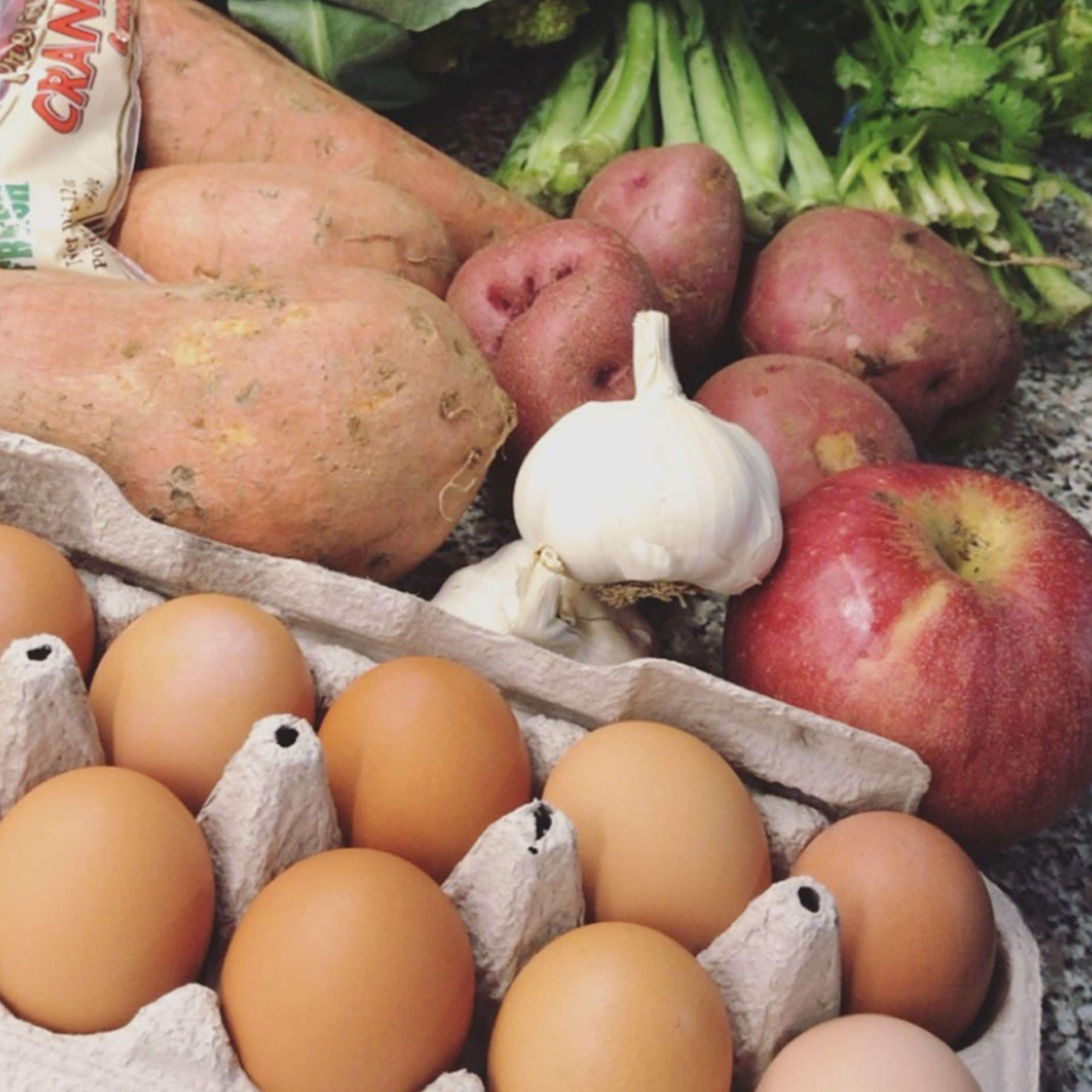 carton of eggs, apple, garlic, potatoes