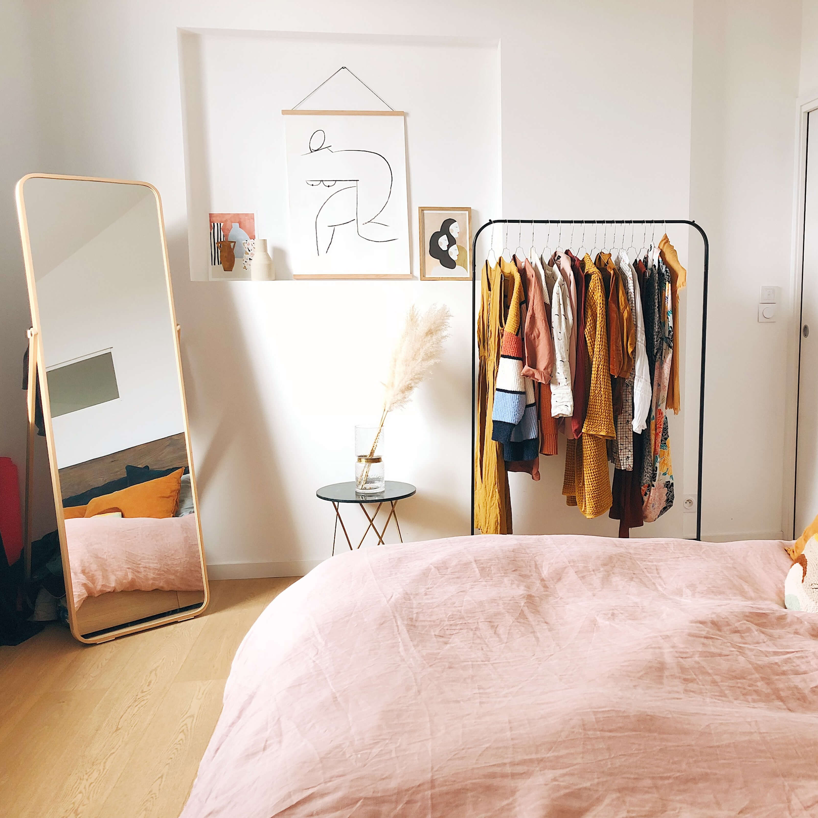bed, mirror, coat rack, paintings