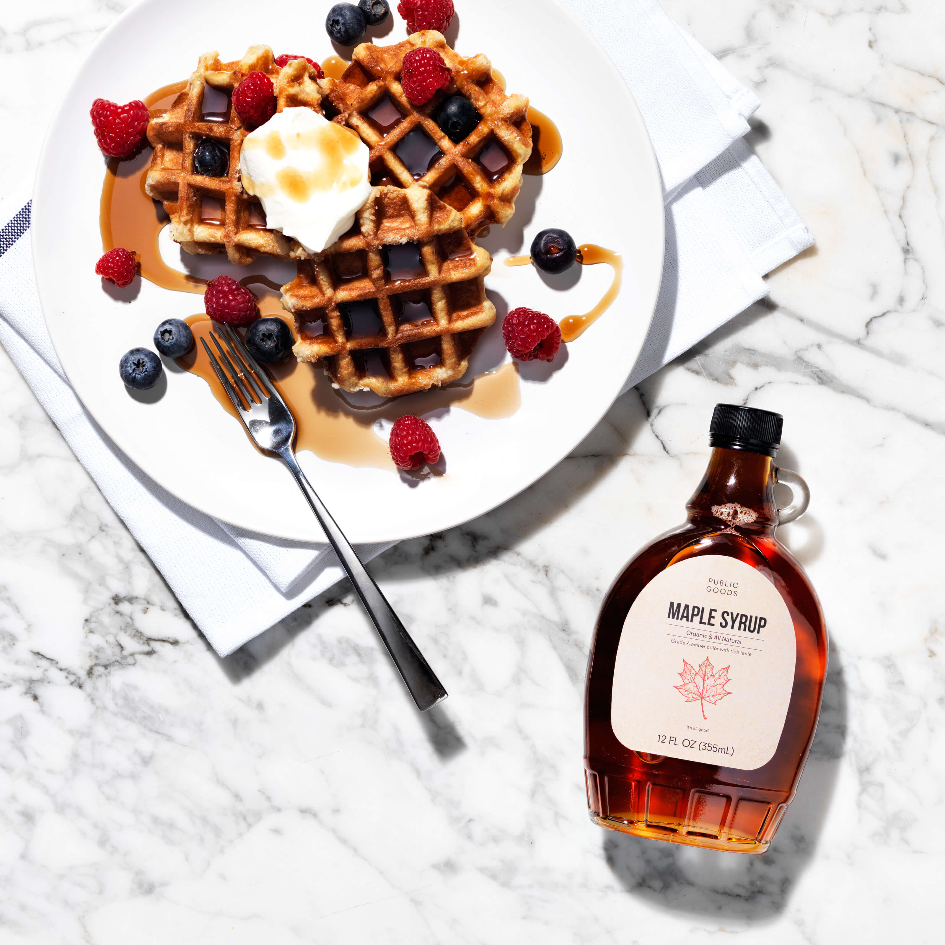 public goods maple syrup, waffles and fork on plate