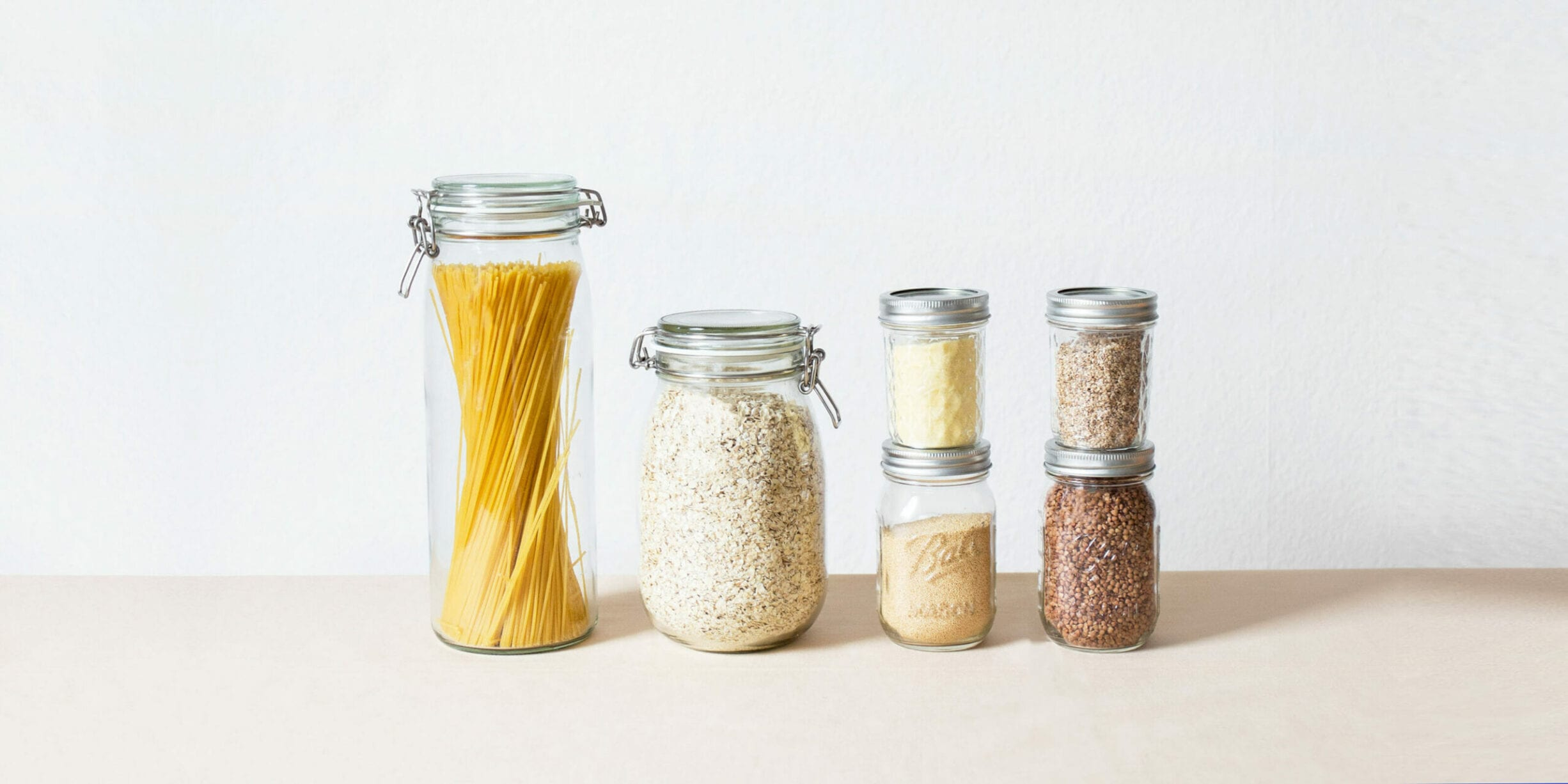 example of precycling using glass mason jars with pasta and spices
