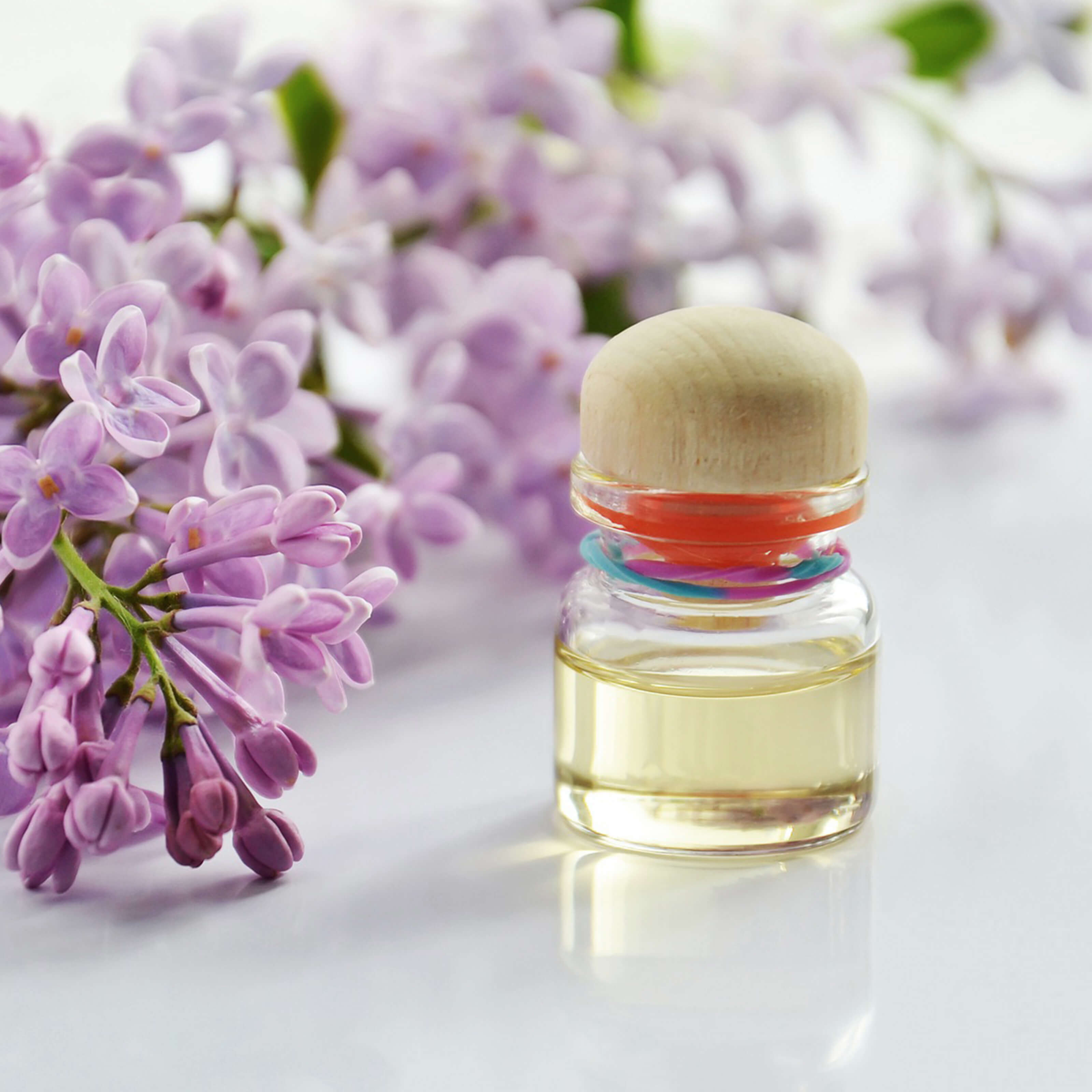 perfume bottle, flowers