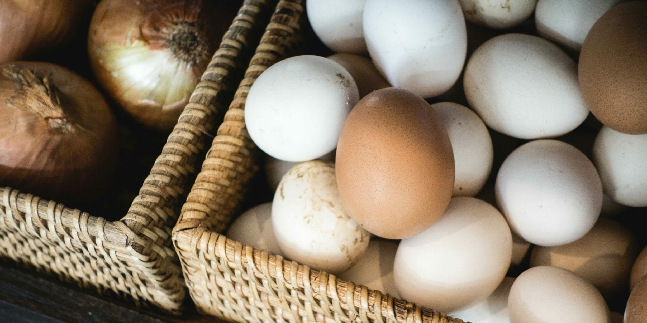 basket of white and brown eggs
