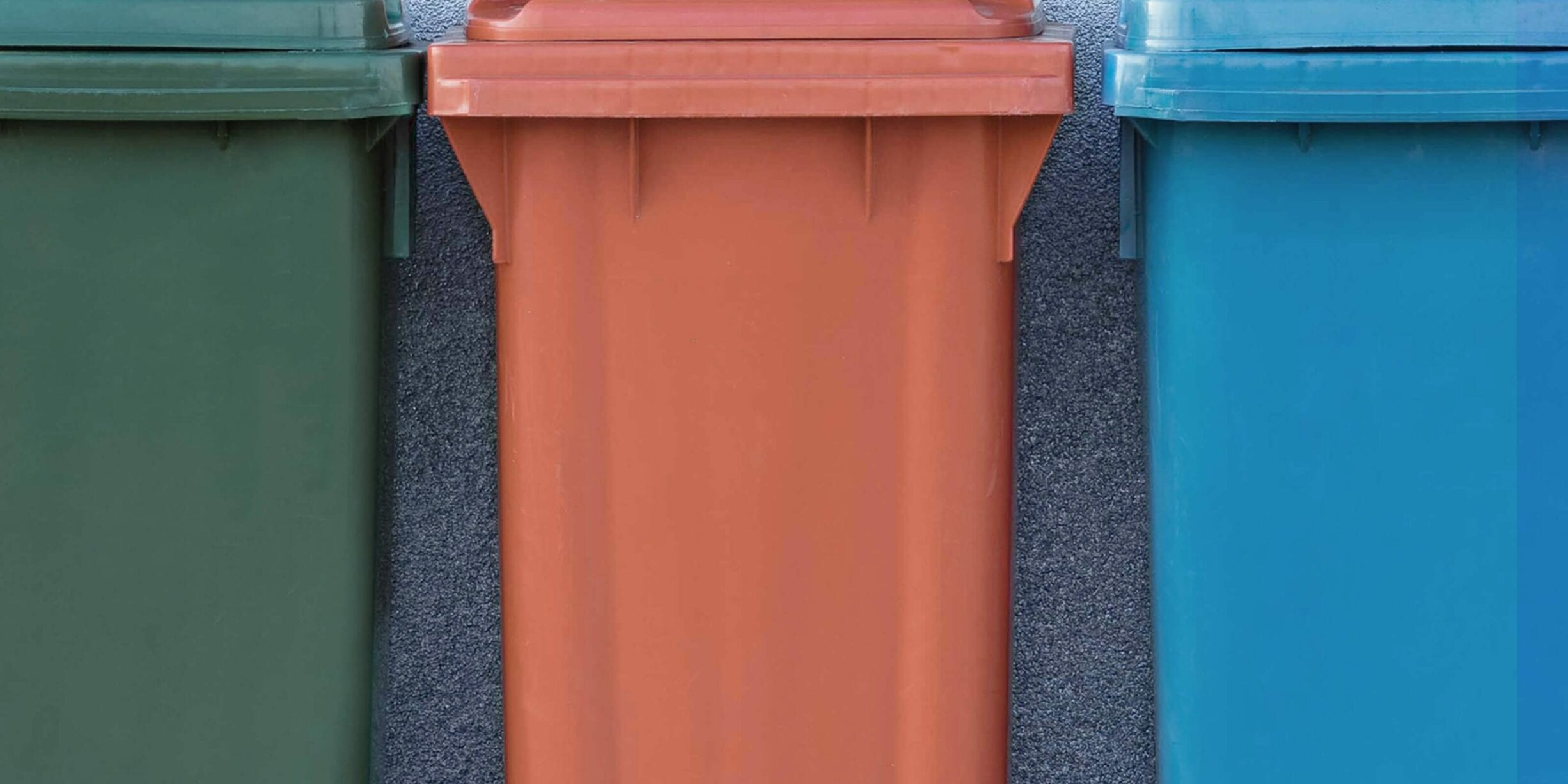 green, orange and blue bins with wheels