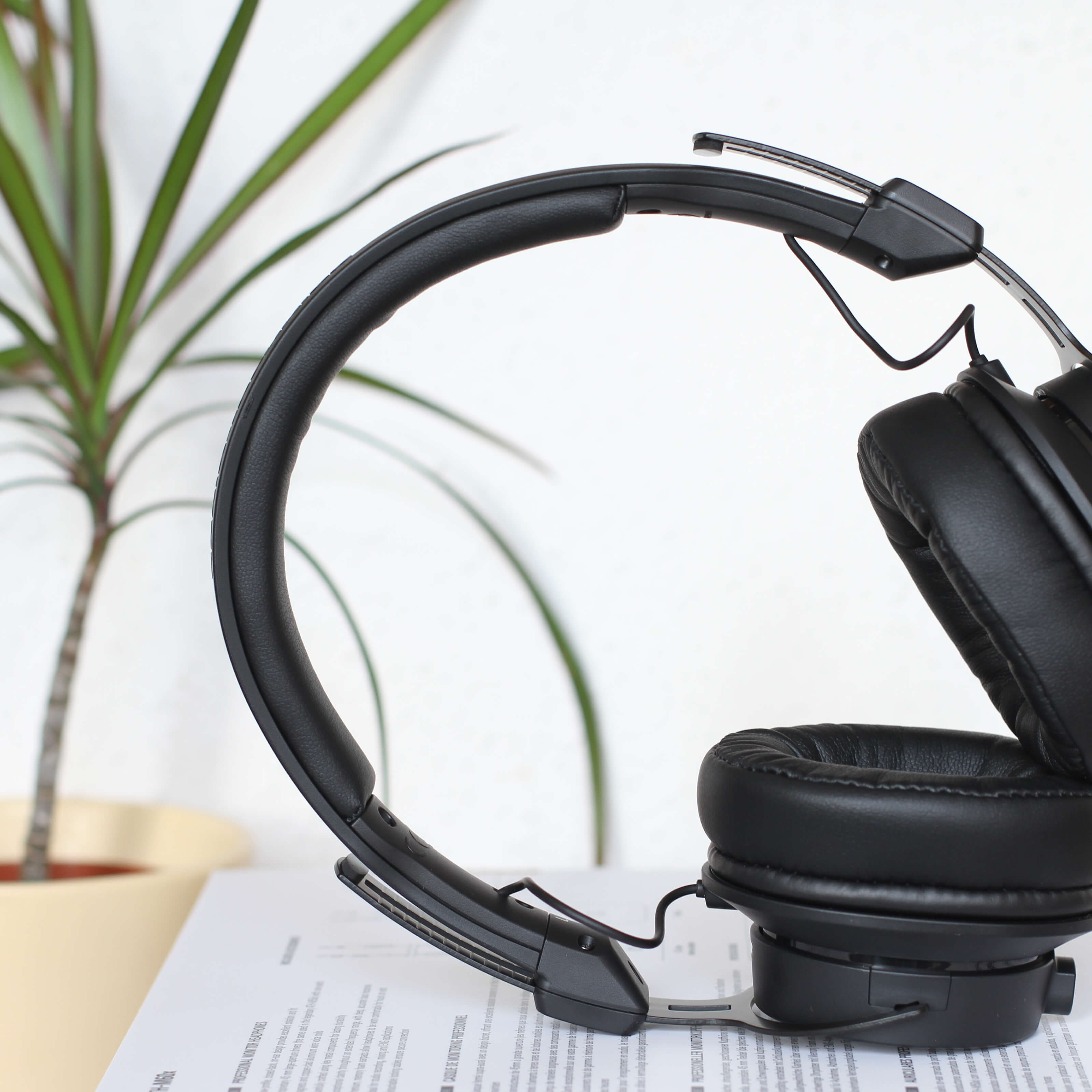 black headphones, paper, house plant