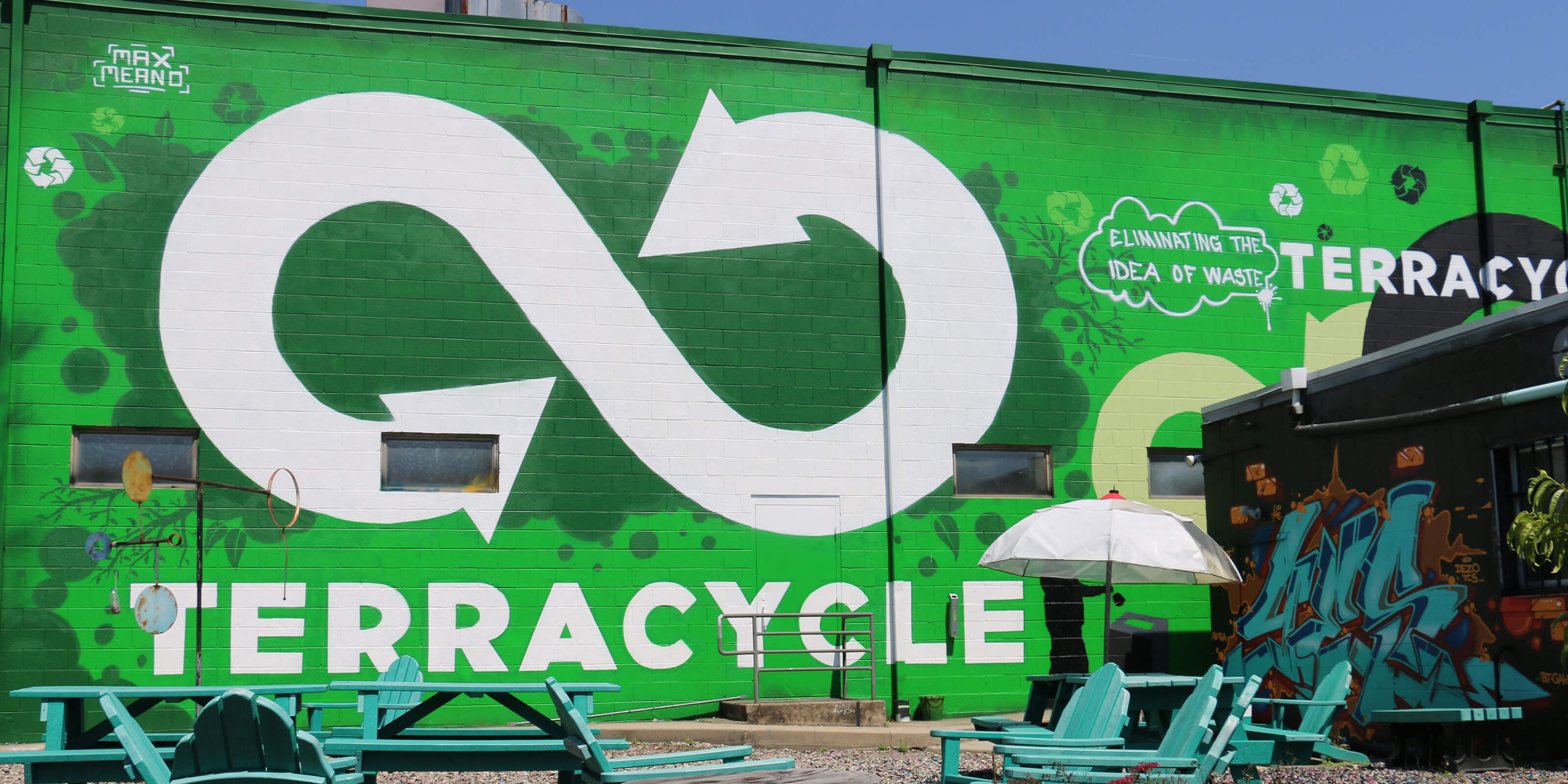 terracycle wall mural, wooden lawn chairs, table