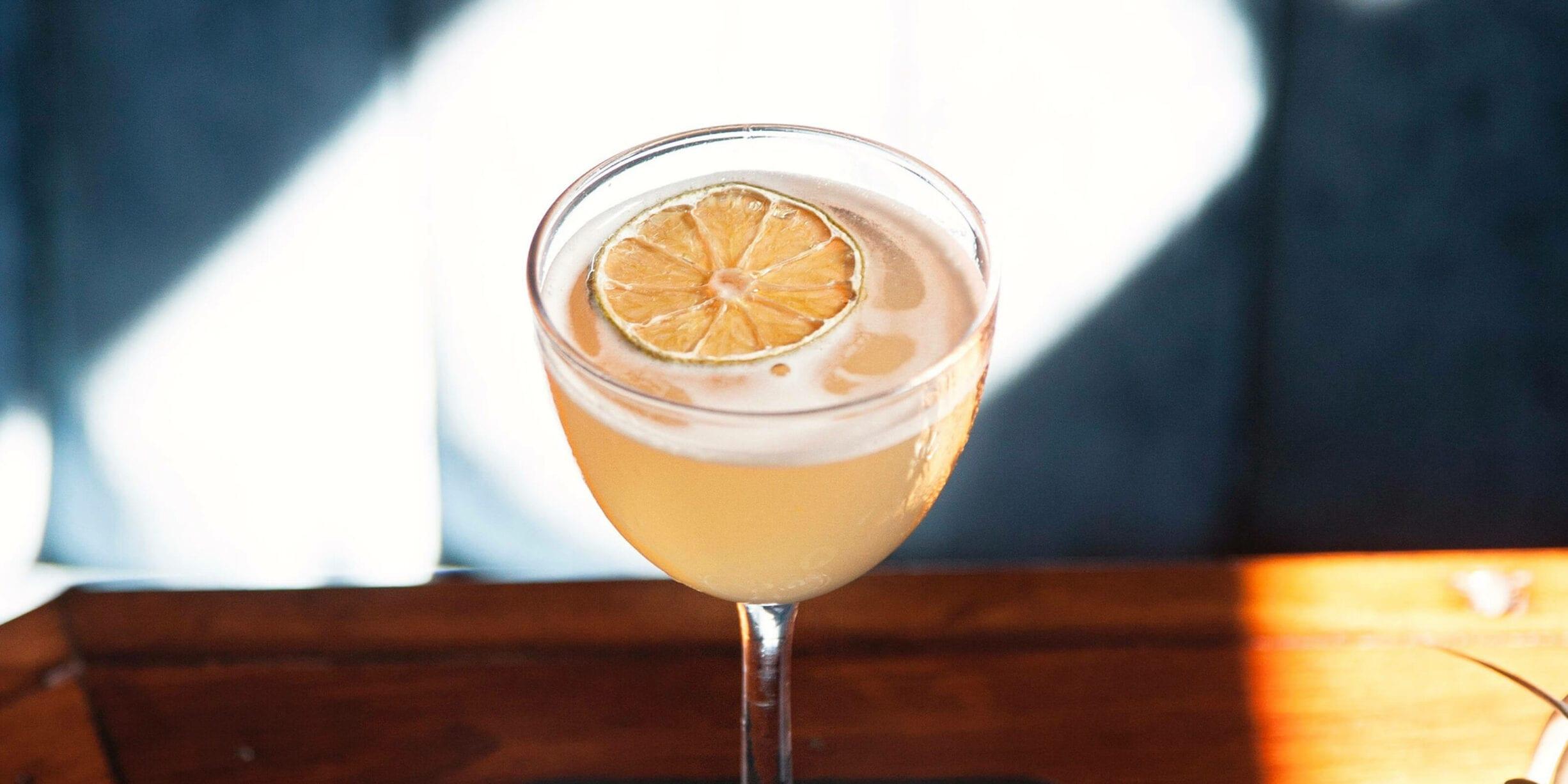 orange slice and cocktail in wine glass