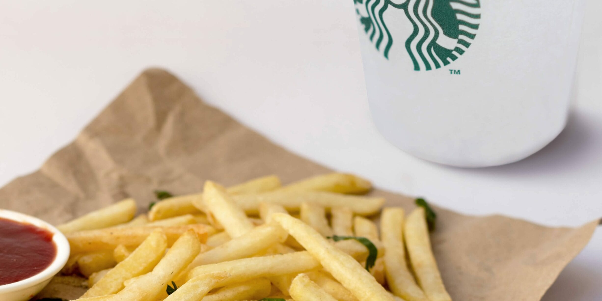 mcdonalds fries, starbucks coffee cup