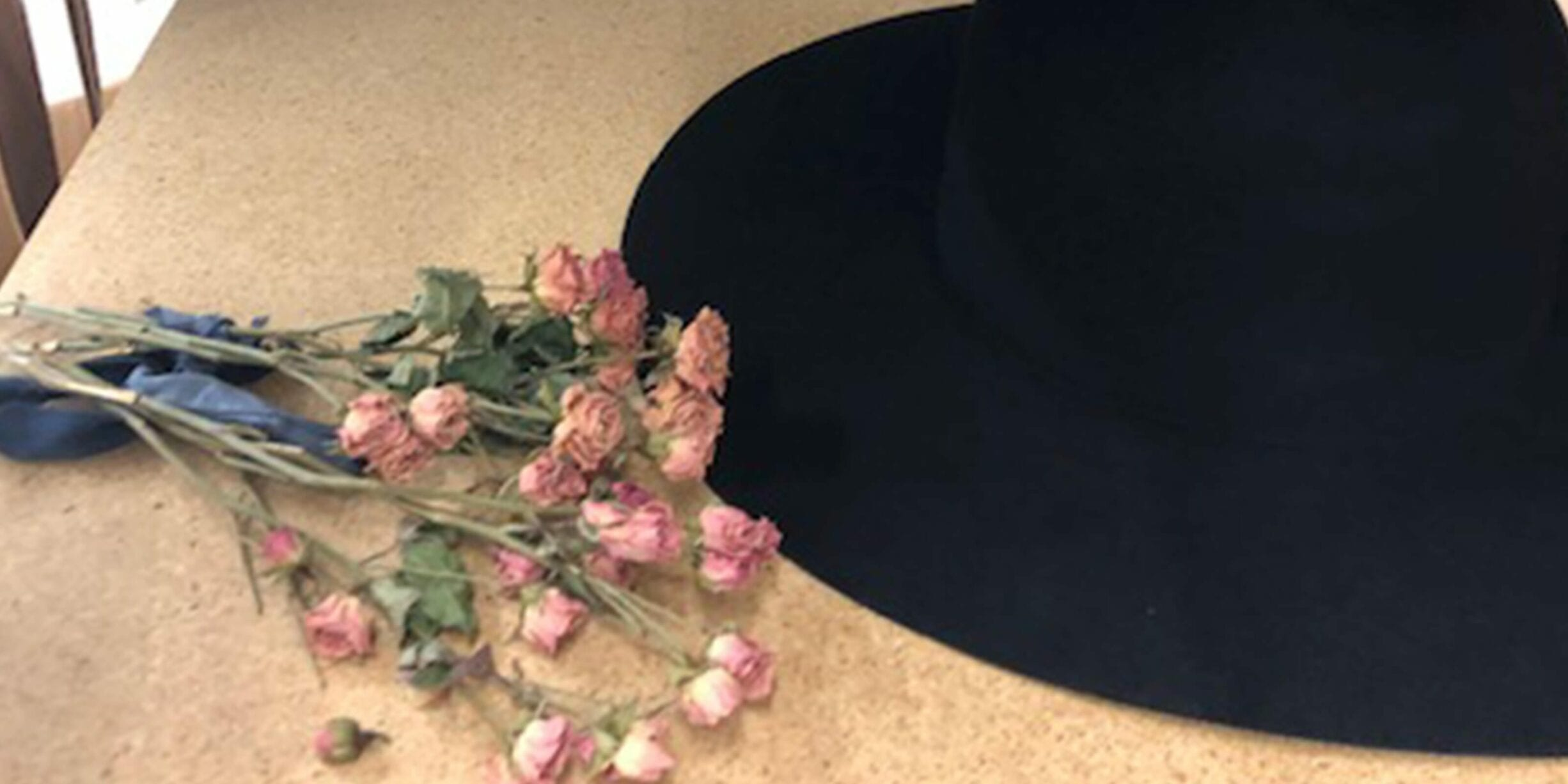 black hat with pink flowers
