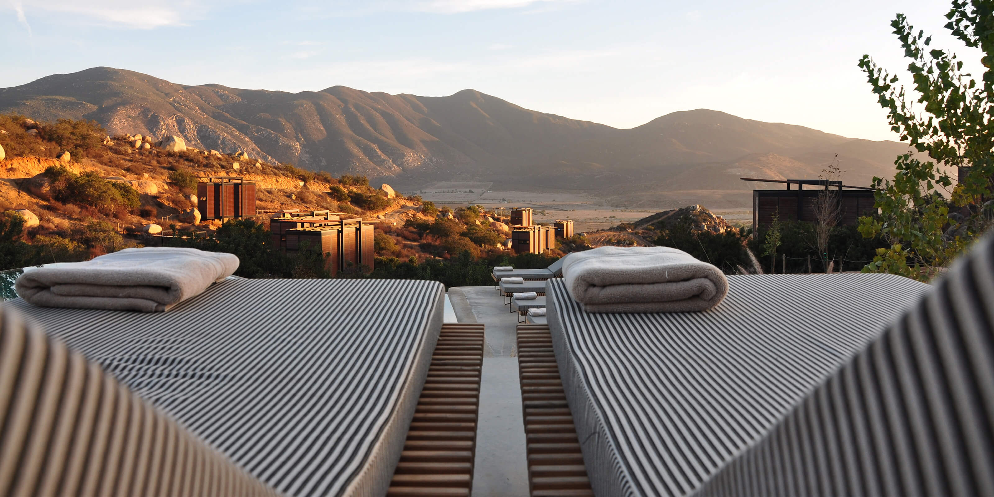 hotel balcony, lawn chairs, mountain view