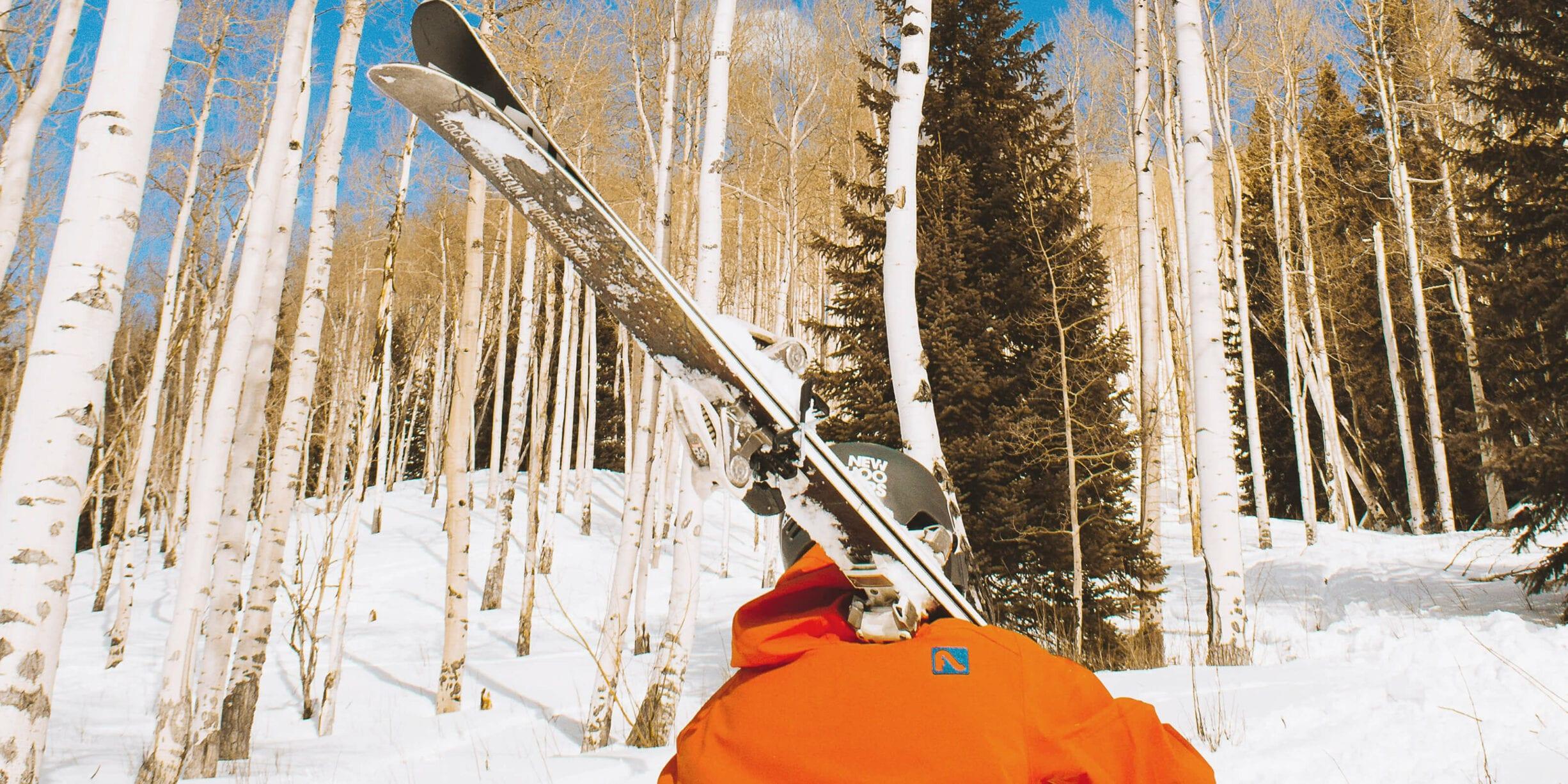 man carrying snowboard
