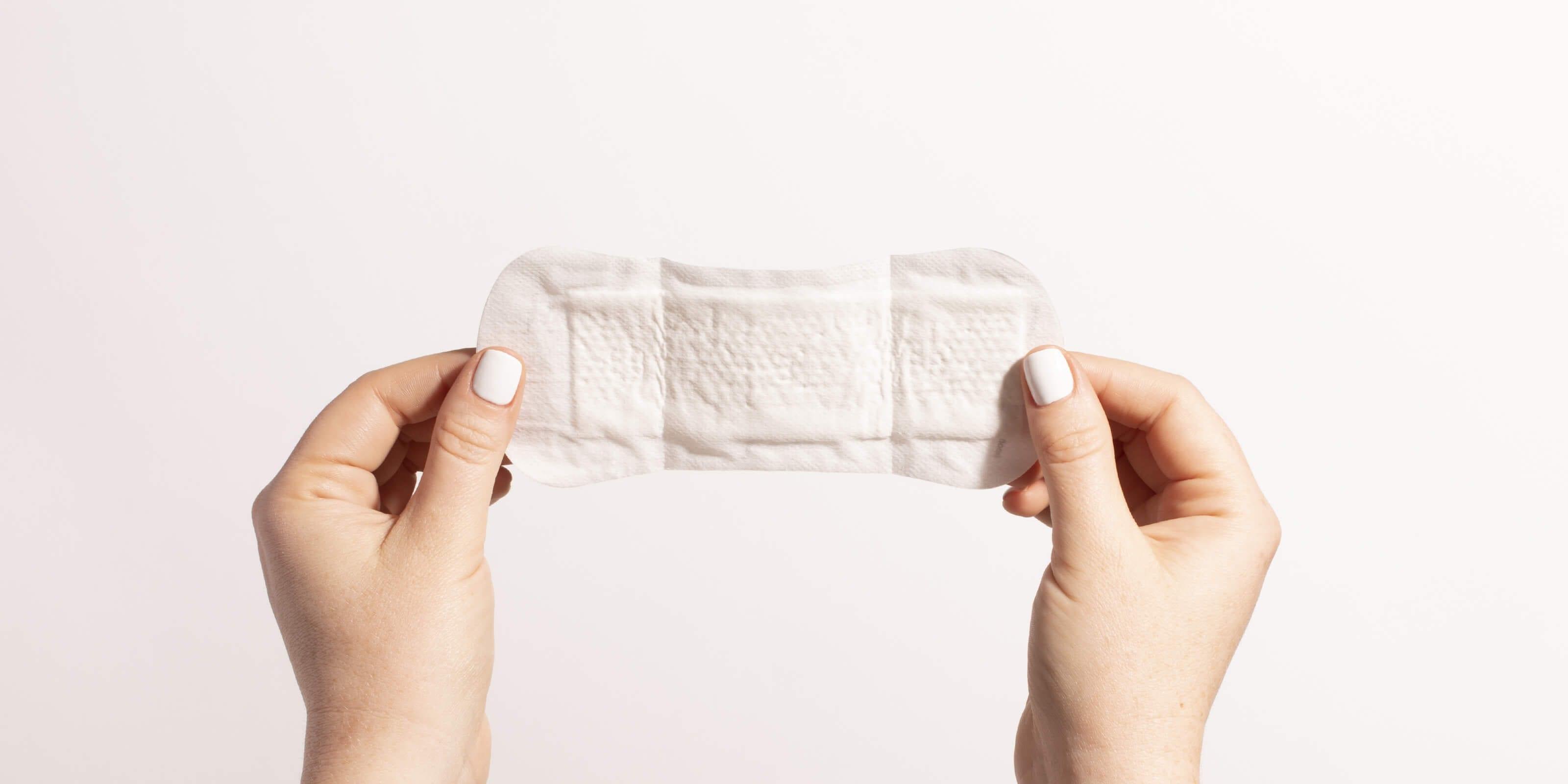 woman holding menstrual pad