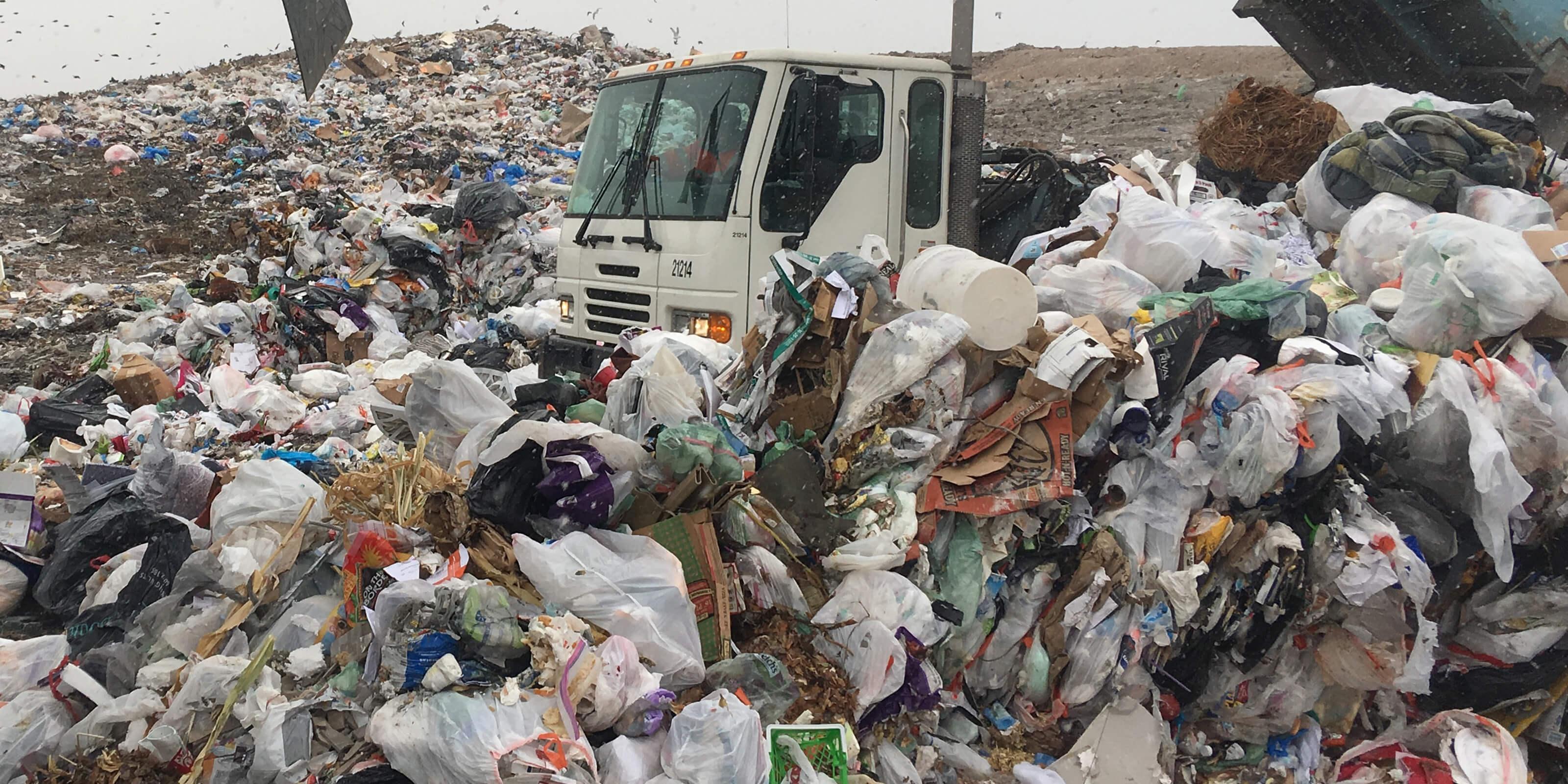 garbage truck dumping in landfill