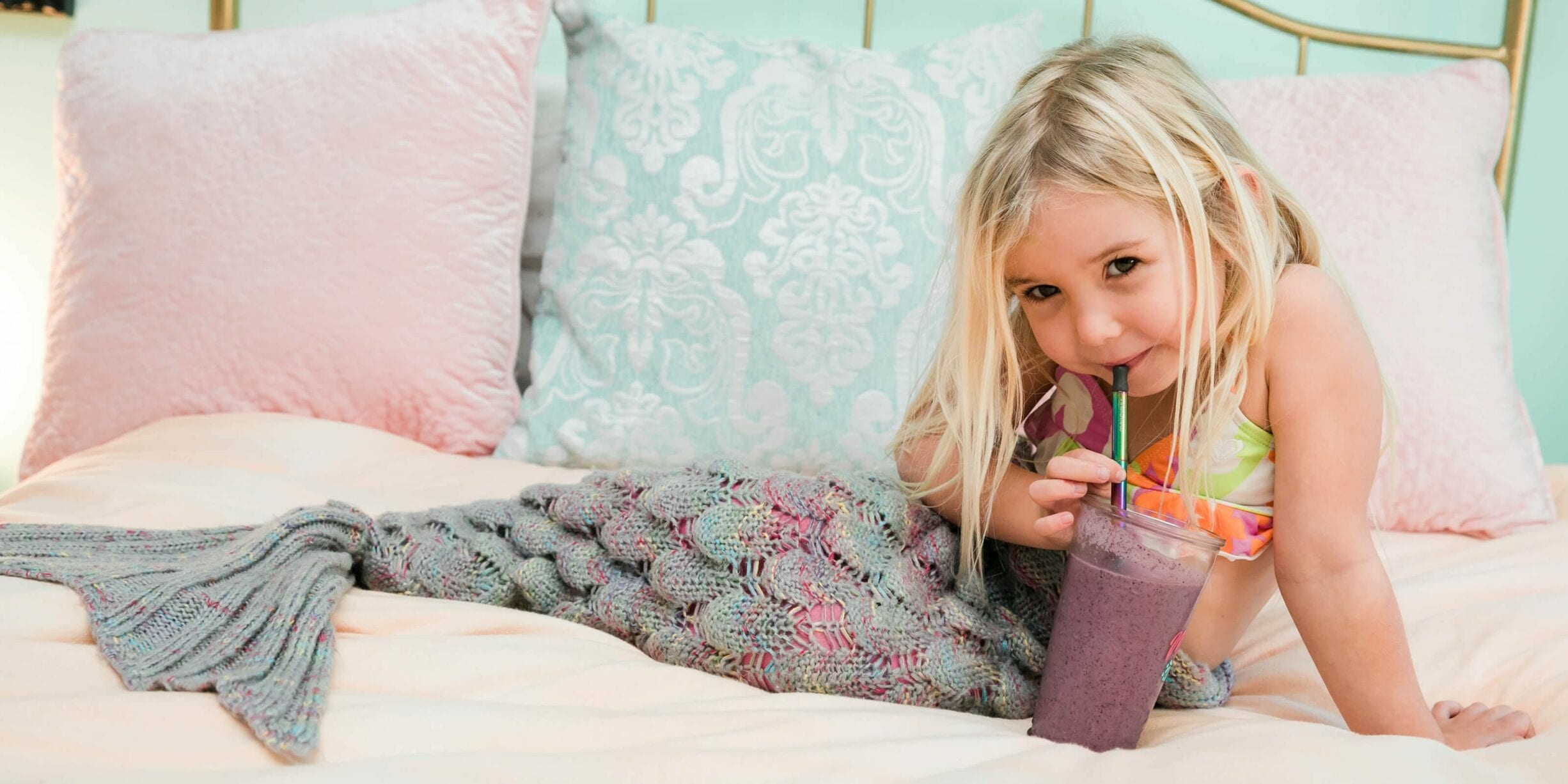 little girl dressed as mermaid sipping smoothie with finalstraw