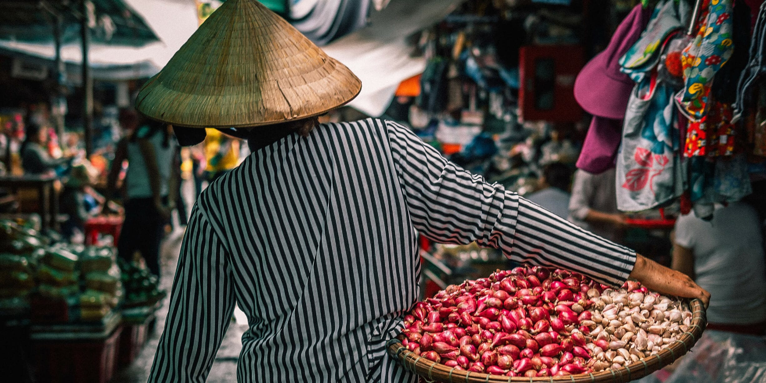 woman in market carrying produce