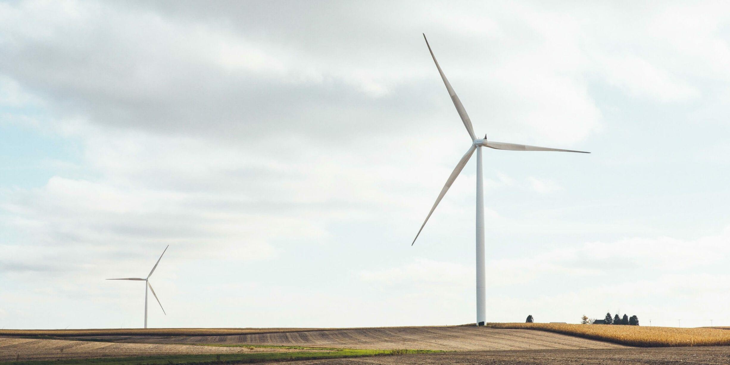 two windmills in field