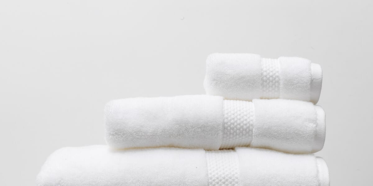 stack of white public goods towels