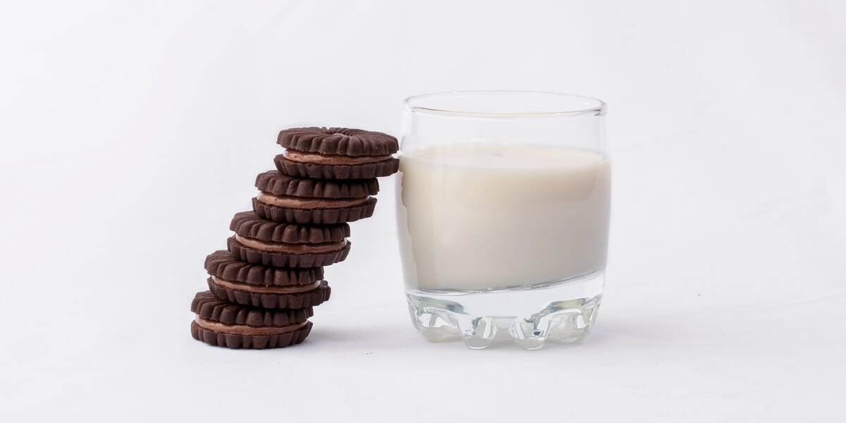 glass of milk, stack of cookies