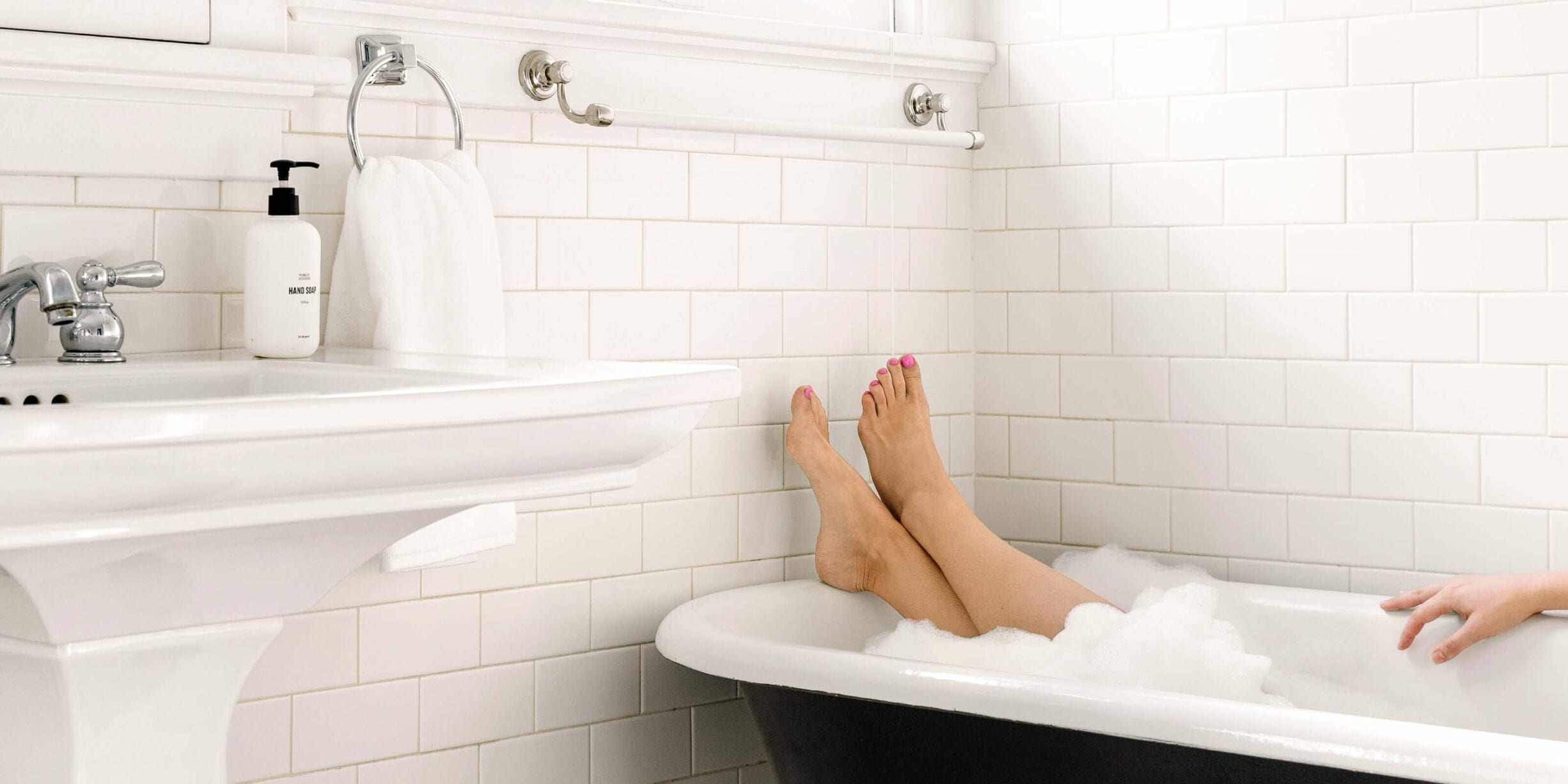 woman in bathtub, soap bubbles, public goods hand soap