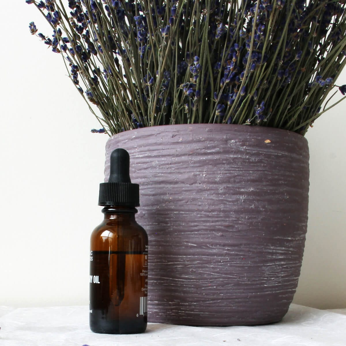 public goods essential oil bottle, pot of lavender