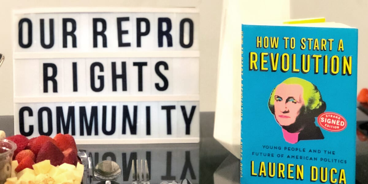 our repro rights community sign, lauren duca book