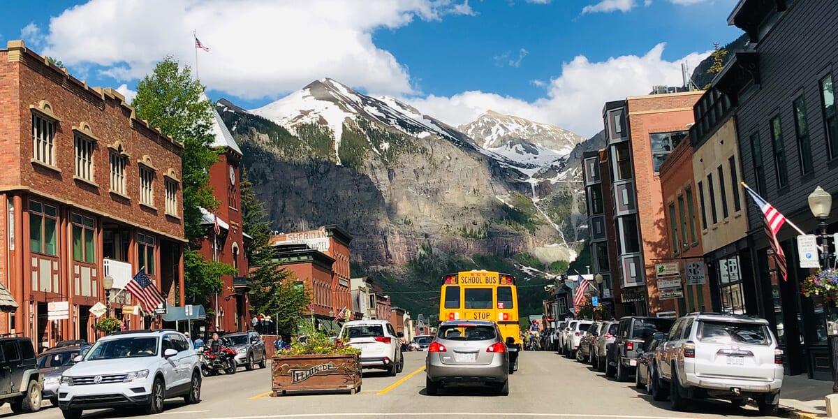telluride main street, mountains, cars, bus