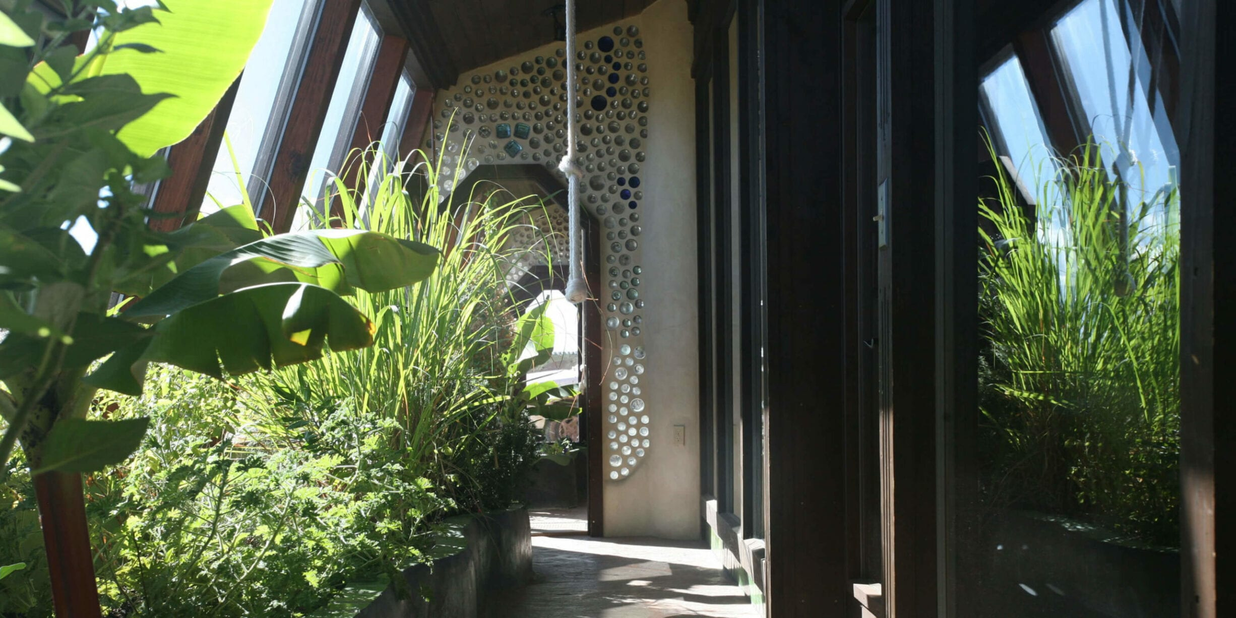 earthship exterior with plants