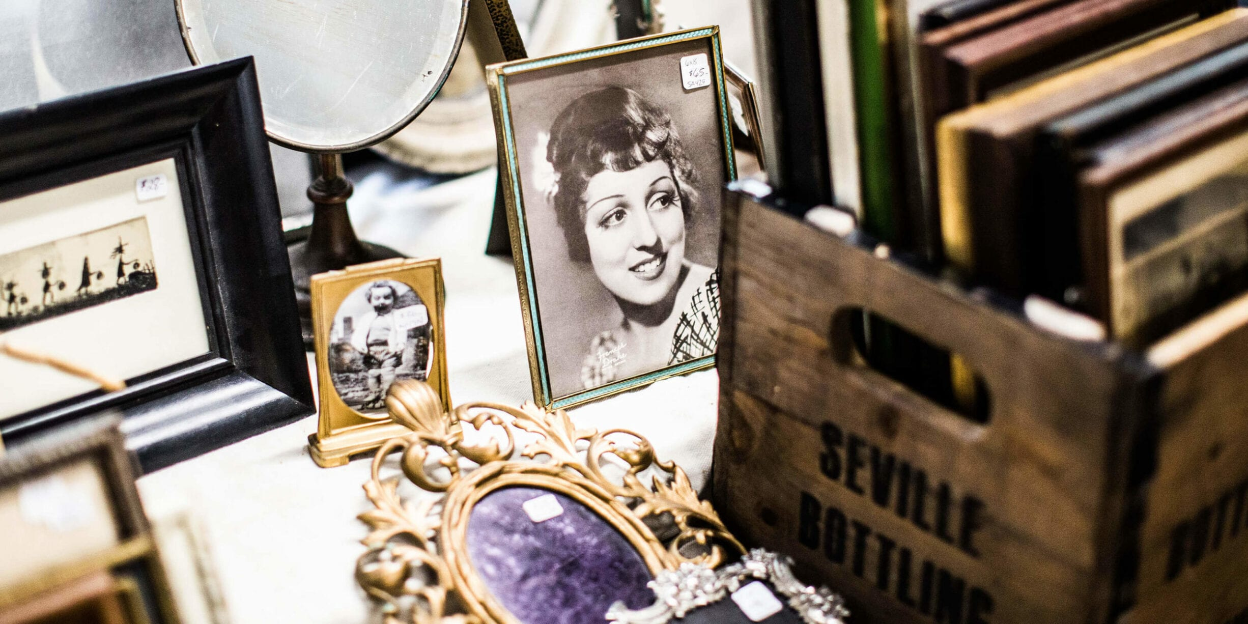 antique shop shelf, picture frames