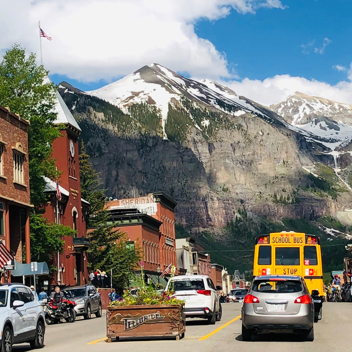 telluride main street, mountains, cars, bus