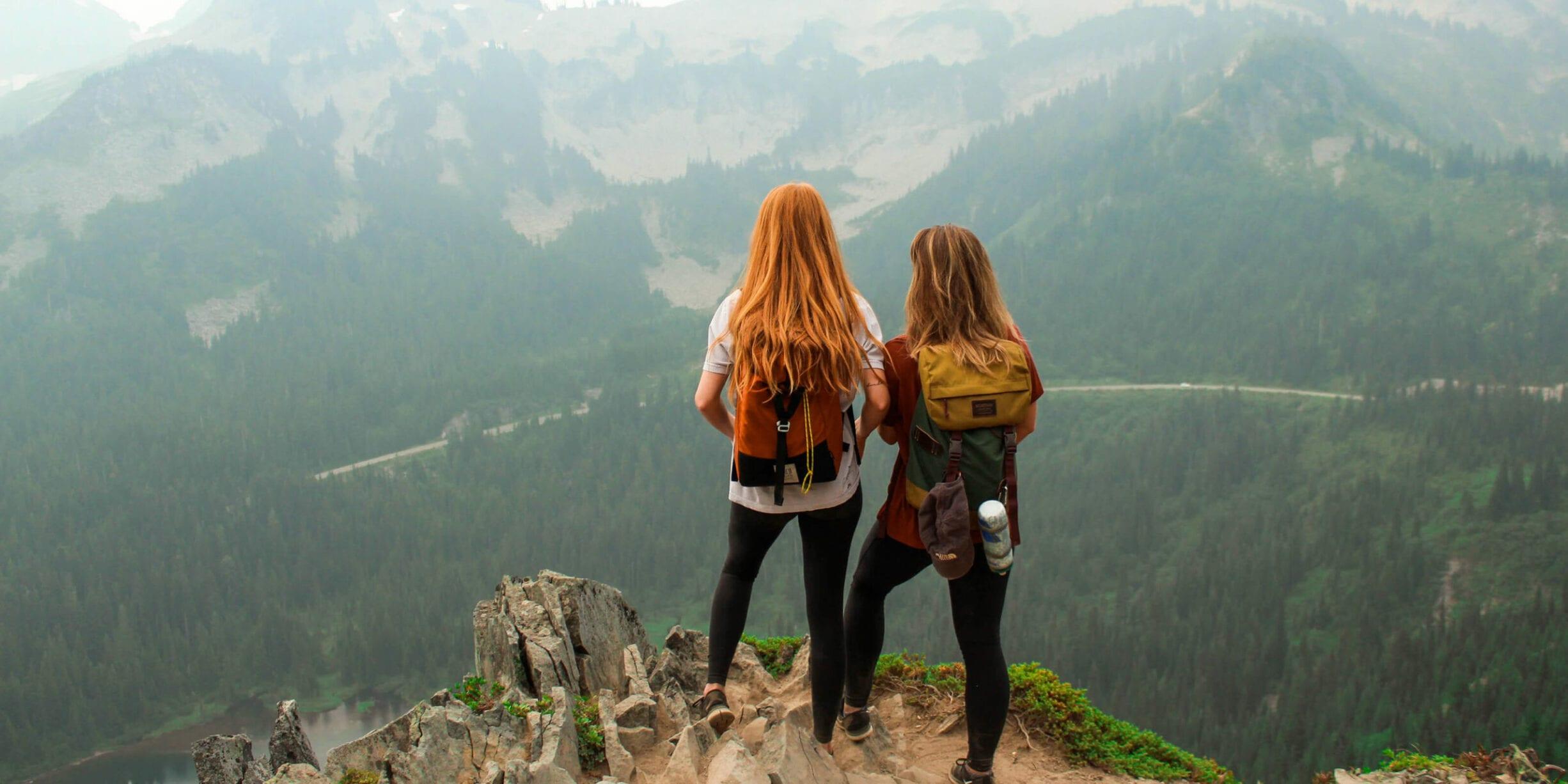 Two women standing on top of Mount Rainier
