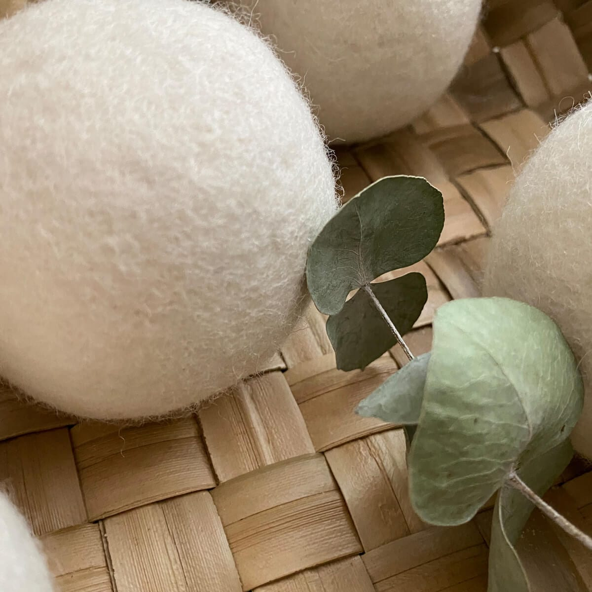 two wool dryer balls, leaf, basket
