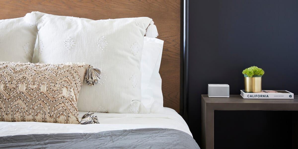 locale bedroom, night table, plant, california book