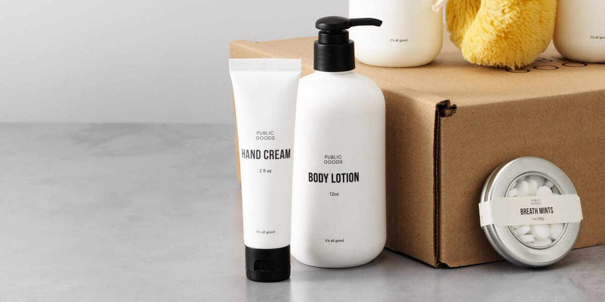 tube of hand cream, bottle of body lotion, cardboard box, mints