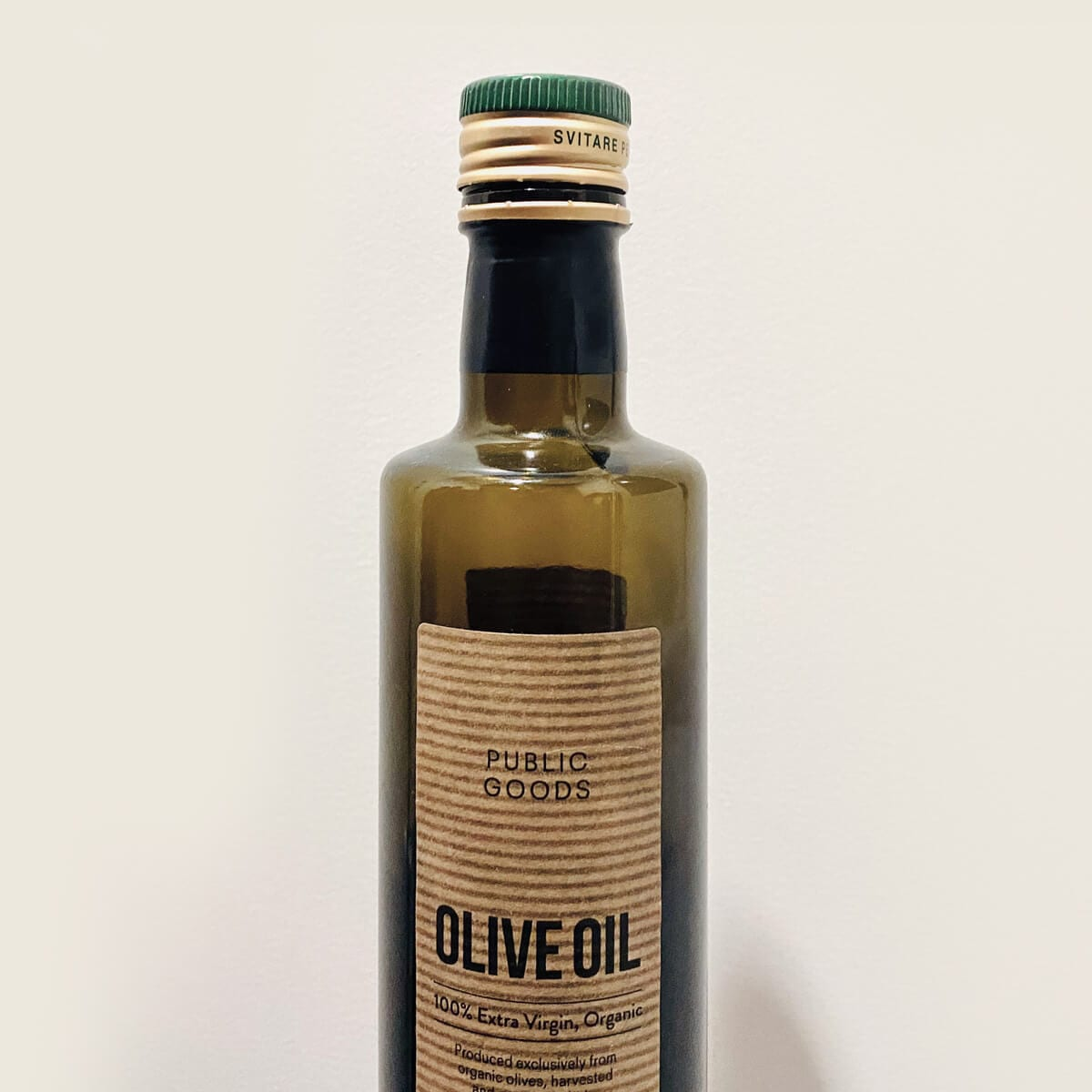 glass bottle of extra virgin olive oil