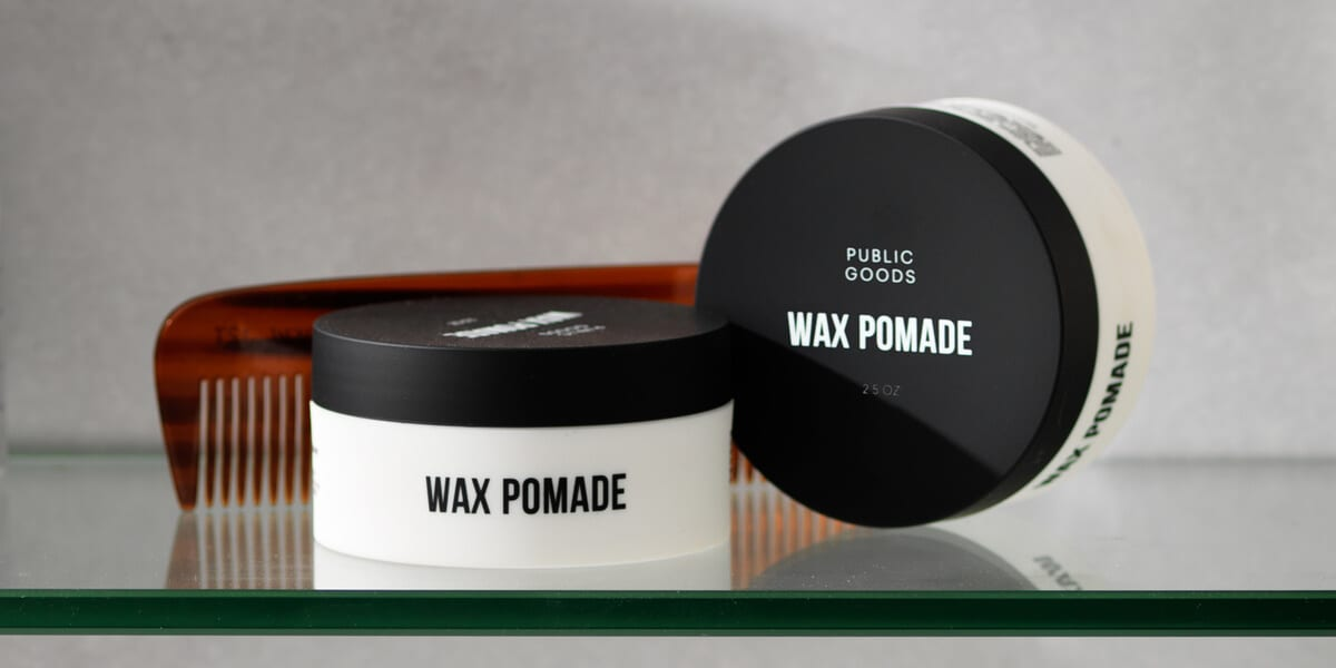 two jars of wax pomade, comb