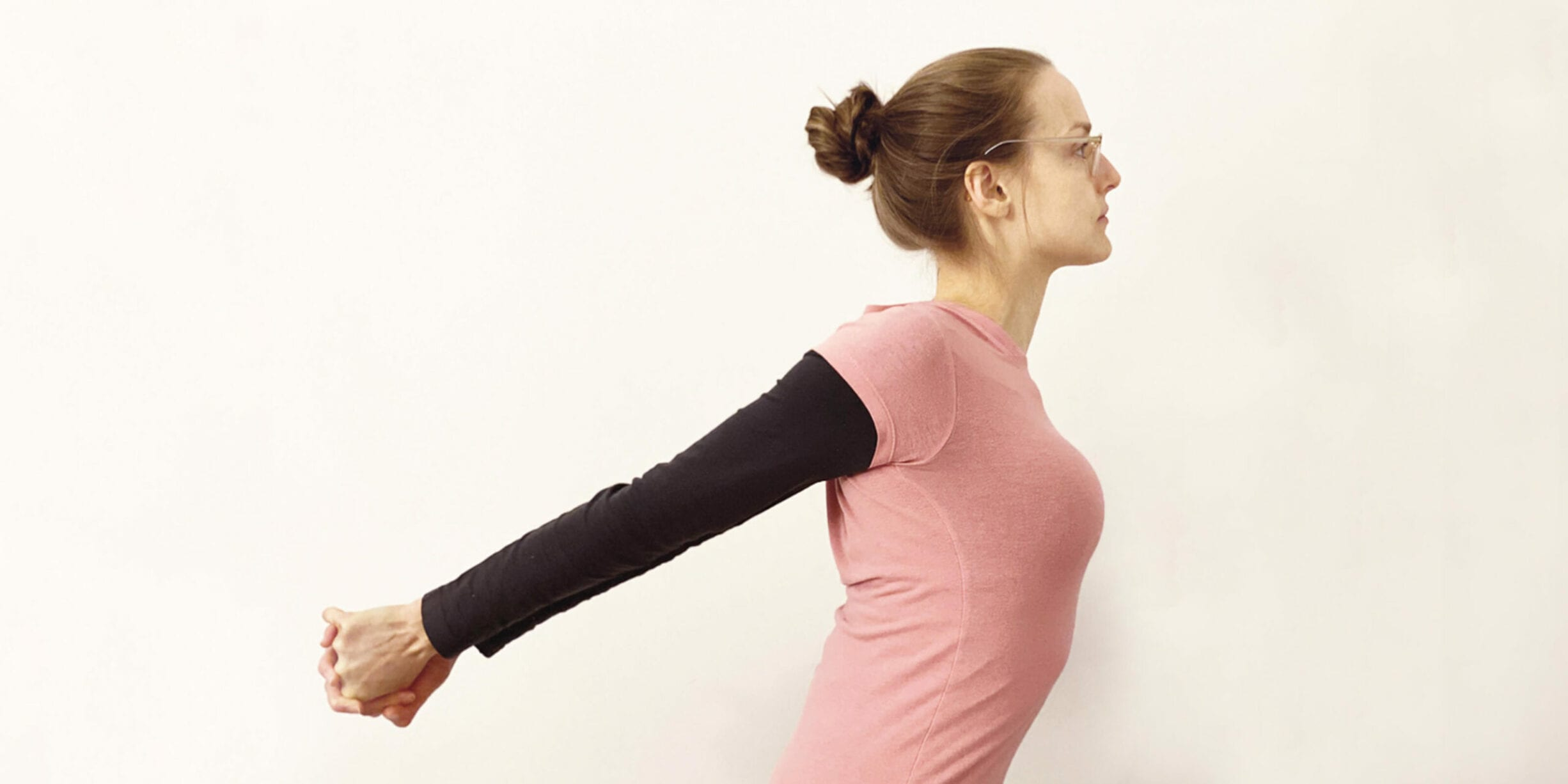 woman doing chest stretch with arms behind