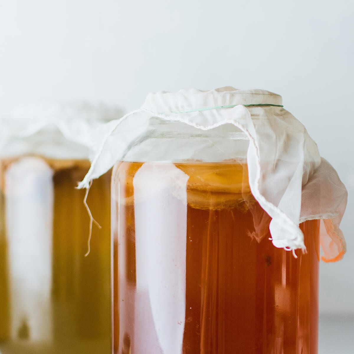 two glass jars of raw honey